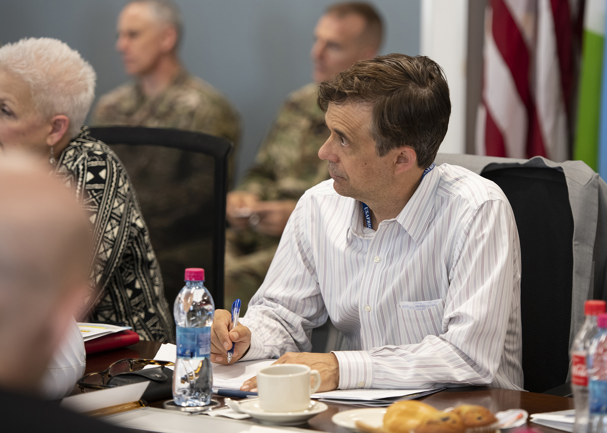 "Amb. Peter Vrooman, U.S. Ambassador to Rwanda, listens to a briefing titled ""Triggers of Regional Instability"" during the Combined Joint Task Force-Horn of Africa (CJTF-HOA) East Africa Security Forum (EASF) at Camp Lemonnier, Djibouti, Dec. 11, 2018. The EASF is an annual opportunity for CJTF-HOA and interagency leaders to sync, assess and align efforts to develop synchronized courses of action that support common goals. (U.S. Air Force photo by Tech. Sgt. Shawn Nickel)"