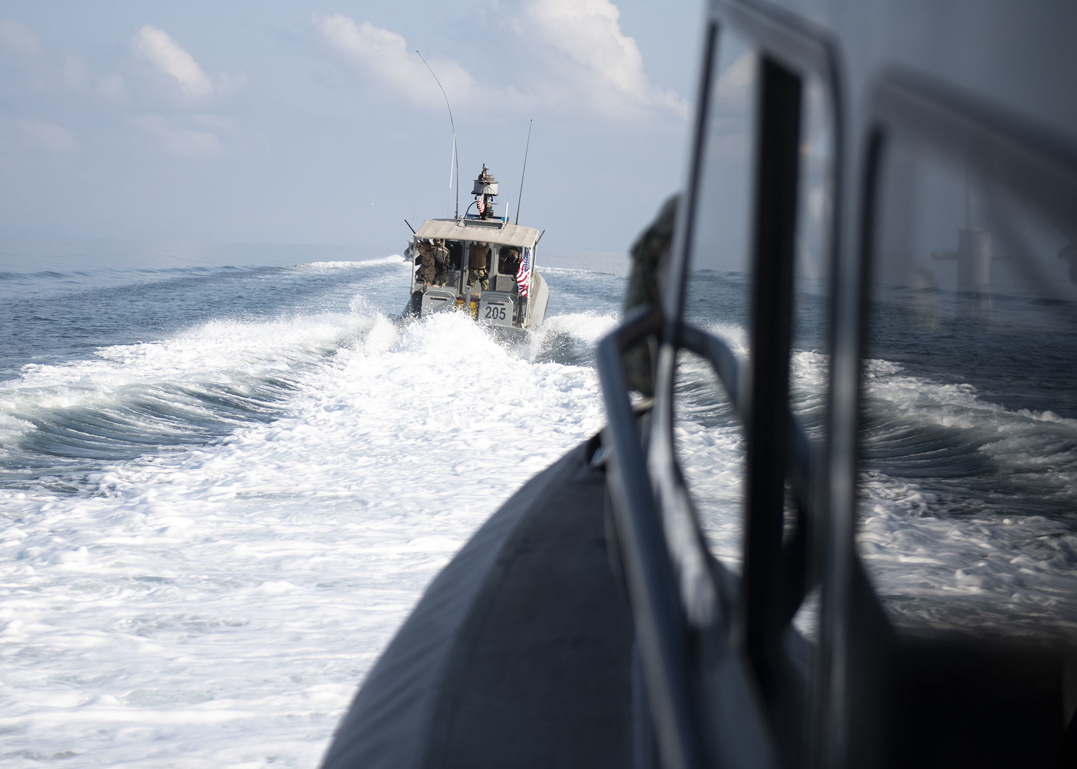 U.S. Navy Sailors from Coastal Riverine Squadron (CRS) 8, Combined Joint Task Force-Horn of Africa, Camp Lemonnier, Djibouti, pilot Rigid Hull Inflatable Boats while en route to provide armed escort to the fleet replenishment oiler USNS Henry J. Kaiser (T-AO 187), in the Gulf of Tadjourah, Dec. 7, 2018. Coastal Riverine Squadron 8 is a hardware-equipped, intelligence, surveillance, reconnaissance embedded, deployable asset that provides centralized planning, control, coordination and integration of its boat and security platoons. (U.S. Air Force photo by Tech. Sgt. Shawn Nickel)