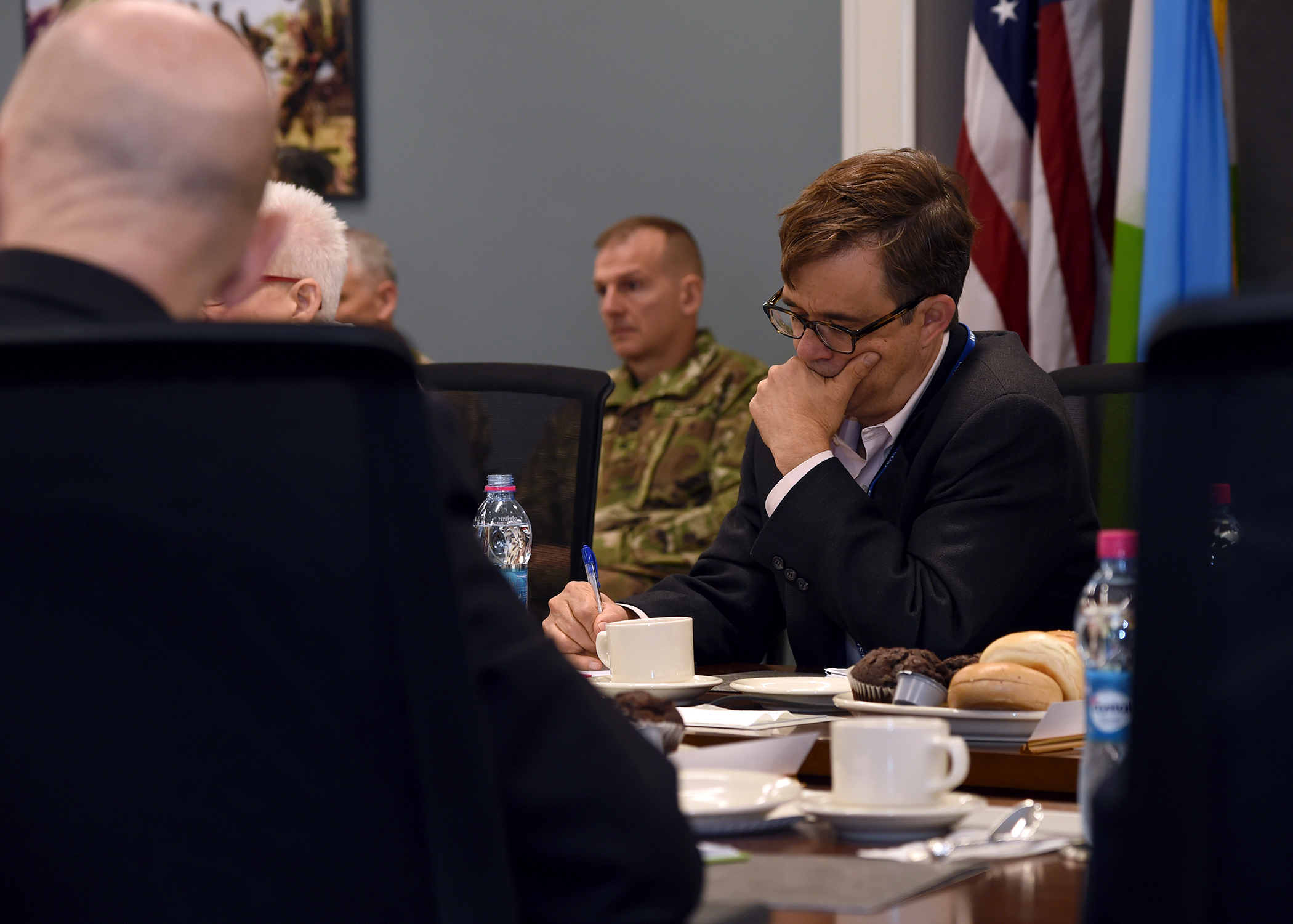 Amb. Peter Vrooman, U.S. Ambassador to Rwanda, takes notes during a meeting at the Combined Joint Task Force-Horn of Africa (CJTF-HOA) East Africa Security Forum (EASF) at Camp Lemonnier, Djibouti, Dec. 13, 2018. The EASF provides opportunities for CJTF-HOA and interagency leaders to assess and align efforts, and develop synchronized courses of action that support common goals. (U.S. Navy photo by Mass Communication Specialist 1st Class Nick Scott)