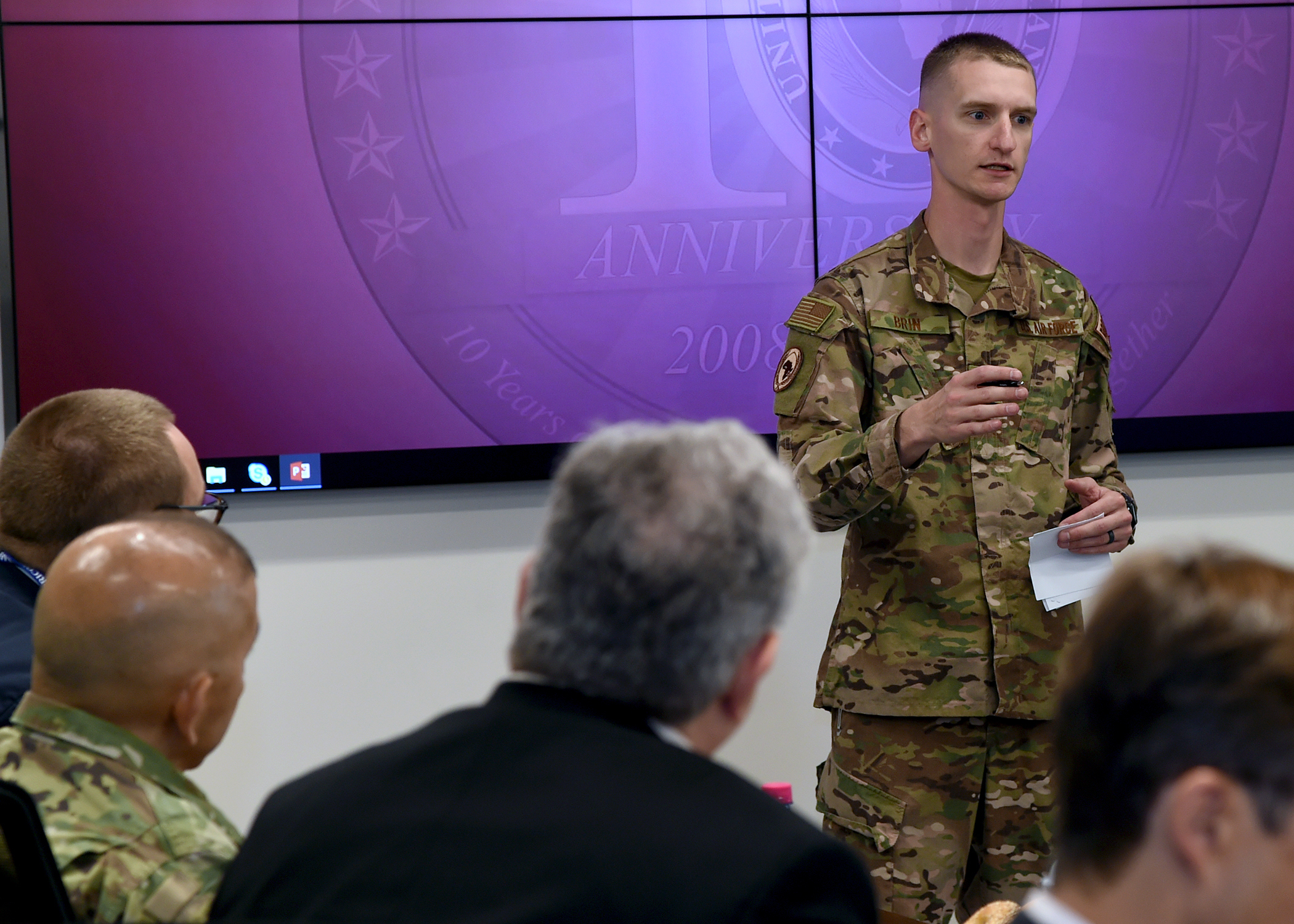 U.S. Air Force Capt. Tyler Brin, director of protocol for Combined Joint Task Force-Horn of Africa (CJTF-HOA), addresses U.S. diplomats and joint service personnel at a meeting during the East Africa Security Forum (EASF) at Camp Lemonnier, Djibouti, Dec. 13, 2018. The EASF provides opportunities for CJTF-HOA and interagency leaders to assess and align efforts, and develop synchronized courses of action that support common goals. (U.S. Navy photo by Mass Communication Specialist 1st Class Nick Scott)