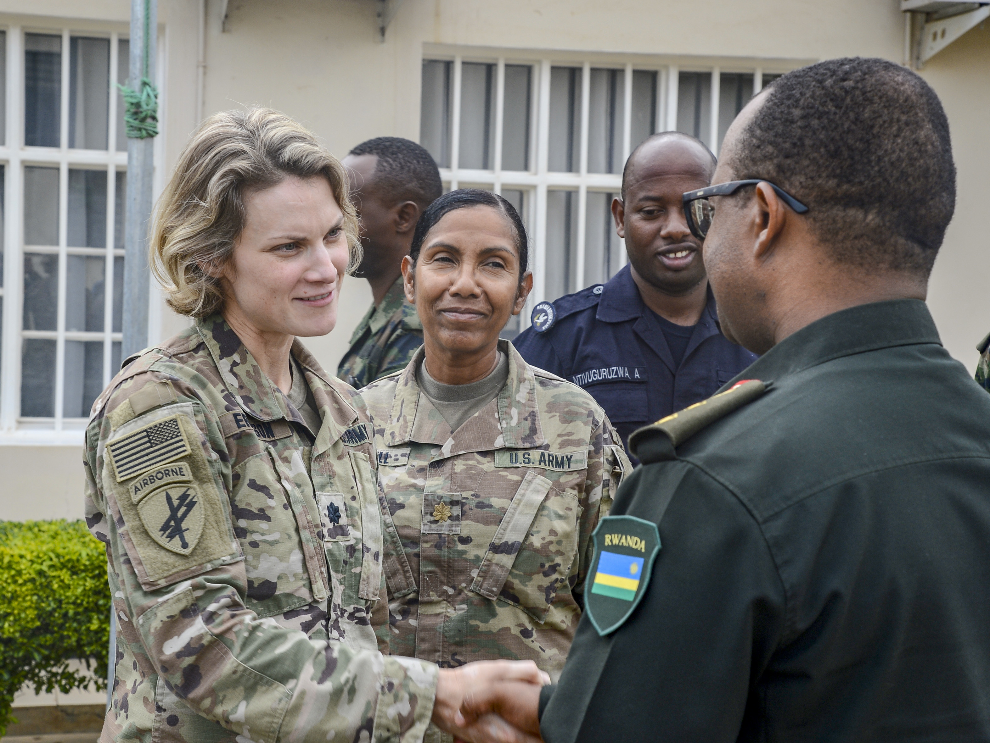 U.S. Army Lt. Col. Delnora Erickson, left, officer in charge, 403rd Civil Affairs Battalion functional specialty team, assigned to Combined Joint Task Force-Horn of Africa (CJTF-HOA), Camp Lemonnier, Djibouti, and U.S. Army Maj. Dionicia Russell, a public health nurse assigned to the 403rd Civil Affairs Battalion, meet with Rwanda Defence Force Col. Eugene Ngoga, Rwanda Military Hospital (RMH) clinical director, at the RMH in Kigali, Rwanda, Nov. 30, 2018.  Erickson and Russell were at RMH participating in a weeklong subject matter expert exchange alongside U.S. military medical personnel assigned to CJTF-HOA and Landstuhl Regional Health Center, Germany. (U.S. Navy photo by Mass Communication Specialist 2nd Class Timothy M. Ahearn)