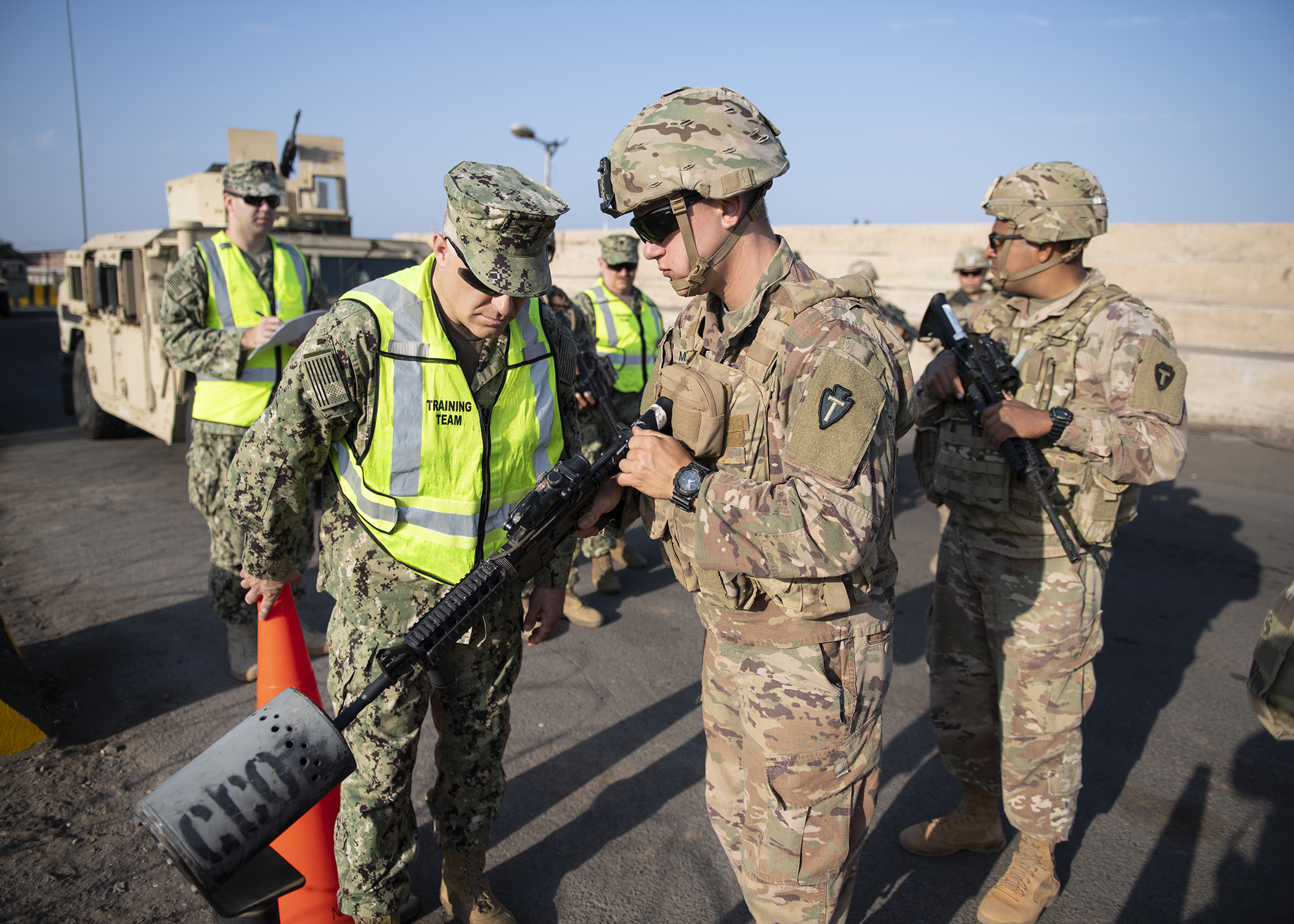 U.S. Navy Capt. Charles DeGilio, left, commanding officer, Camp Lemonnier, Djibouti, ensures Task Force Alamo weapons are safe and clear of ammunition prior to the first-ever U.S. military exercise at the Port of Djibouti, Djibouti, Dec. 19, 2018. The exercise integrated U.S. Navy, Army and Djibouti Port Authority assets. (U.S. Air Force photo by Tech. Sgt. Shawn Nickel)