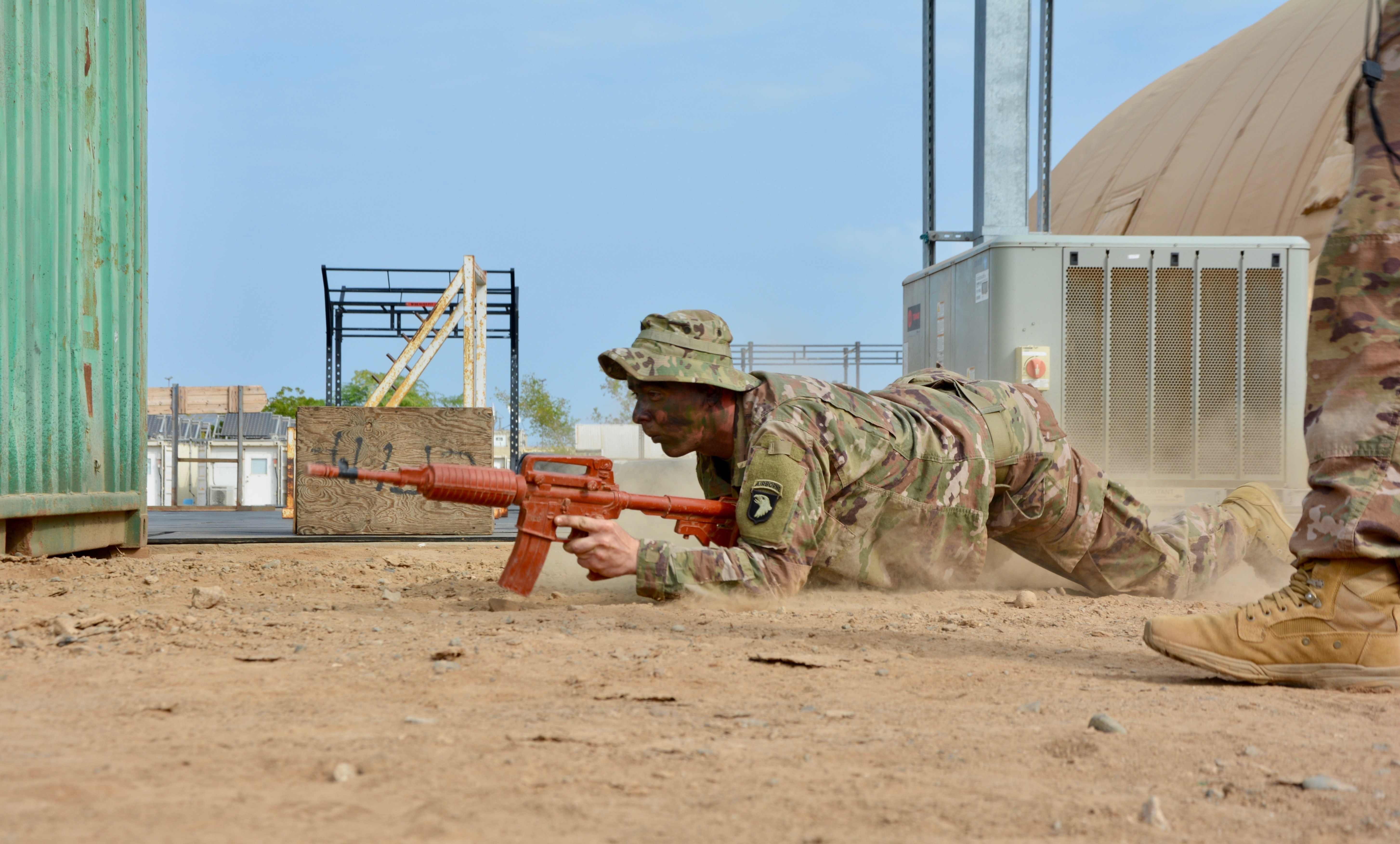 A U.S. Army Soldier, assigned to Bravo Company, 1st Battalion, 26th Infantry Regiment, 101st Airborne Division, high crawls to disable a bunker with a hand grenade during training for the Expert Infantryman Badge at Camp Lemonnier, Djibouti, Dec. 18, 2018. Members of the Fort Campbell, Kentucky unit demonstrated a mastery of critical skills that reinforce their ability to respond to emergency situations at U.S. Embassies in the East African region as members of the Combined Joint Task Force-Horn of Africa (CJTF-HOA), East Africa Response Force (EARF).