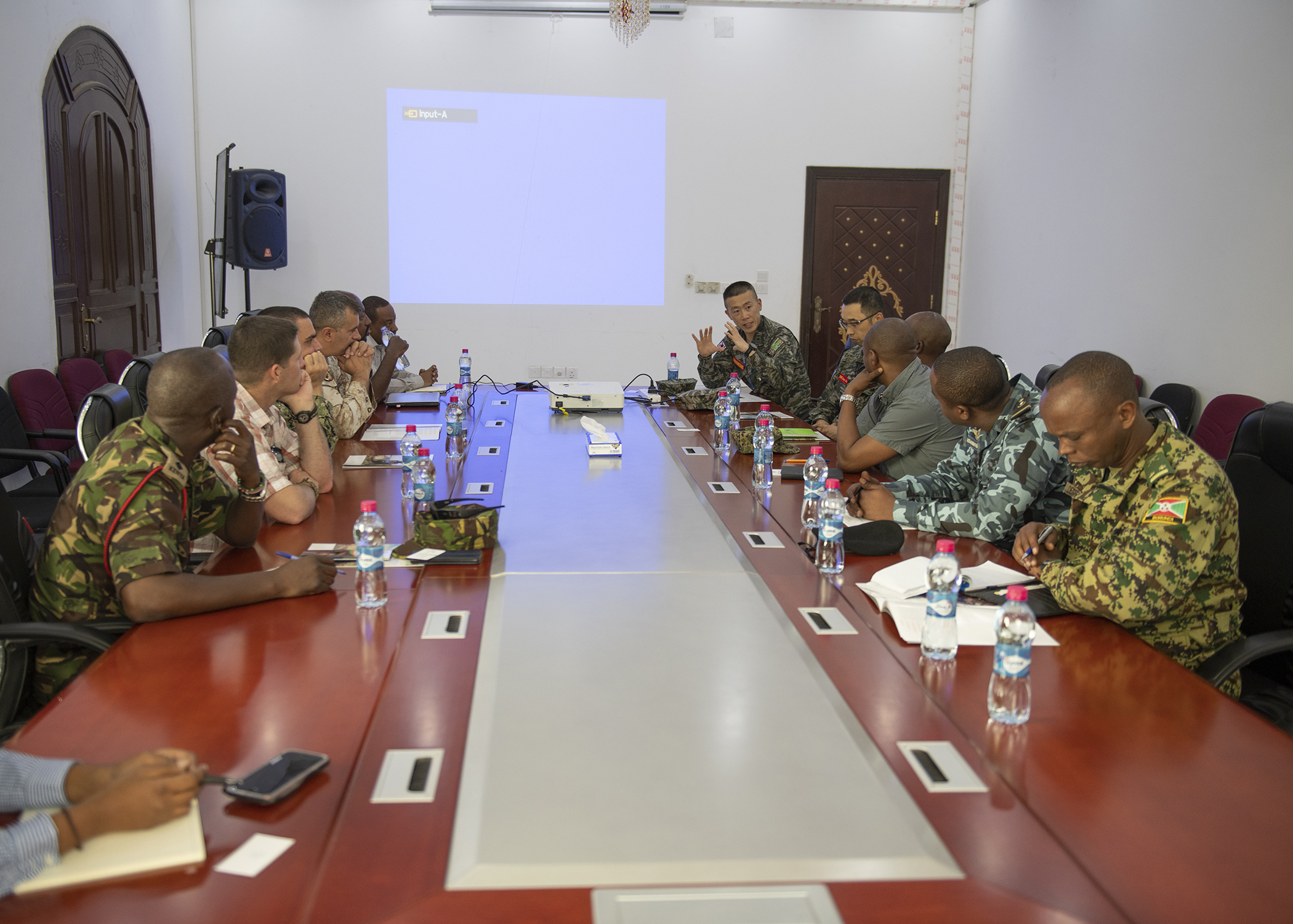 Republic of Korea Marine Maj. Hyunchang Choi, far right end, a foreign liaison officer (FLO) assigned to Combined Joint Task Force-Horn of Africa (CJTF-HOA), starts a discussion during the first-ever formal meeting between FLOs and U.S. military members assigned to CJTF-HOA, and officials from the Intergovernmental Authority on Development in Djibouti, Jan. 16, 2019. The purpose of the meeting was for both parties to familiarize themselves with each other's missions and goals through a short information exchange and set the stance for future meetings. (U.S. Air Force photo by Tech. Sgt. Shawn Nickel)