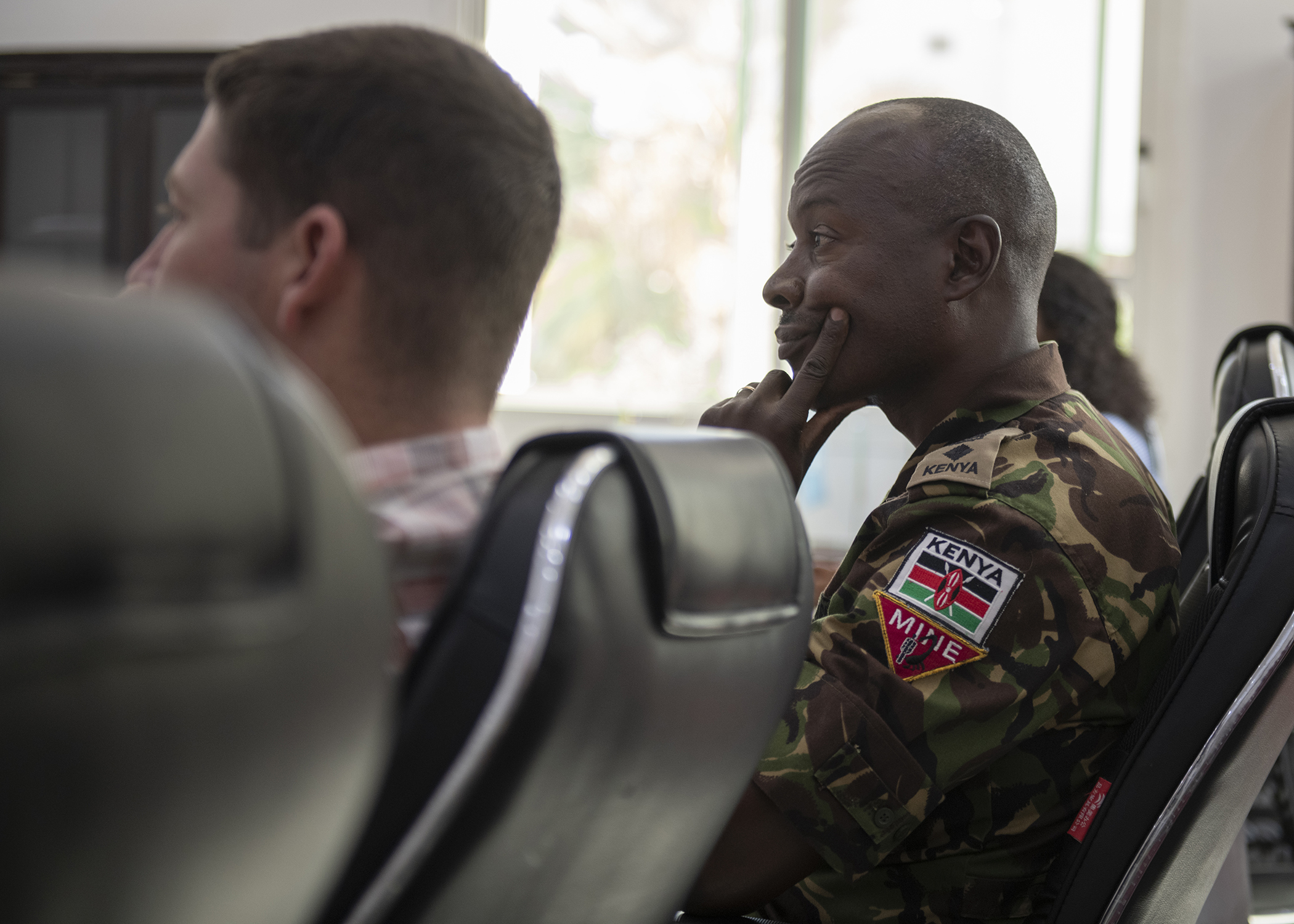 Kenya Army Lt. Col. Ndegwa Mburu, a foreign liaison officer (FLO) assigned to Combined Joint Task Force-Horn of Africa (CJTF-HOA), listens during the first-ever formal meeting between FLOs and U.S. military members assigned to CJTF-HOA, and officials from the Intergovernmental Authority on Development in Djibouti, Jan. 16, 2019. The purpose of the meeting was for both parties to familiarize themselves with each other's missions and goals through a short information exchange and set the stance for future meetings. (U.S. Air Force photo by Tech. Sgt. Shawn Nickel)