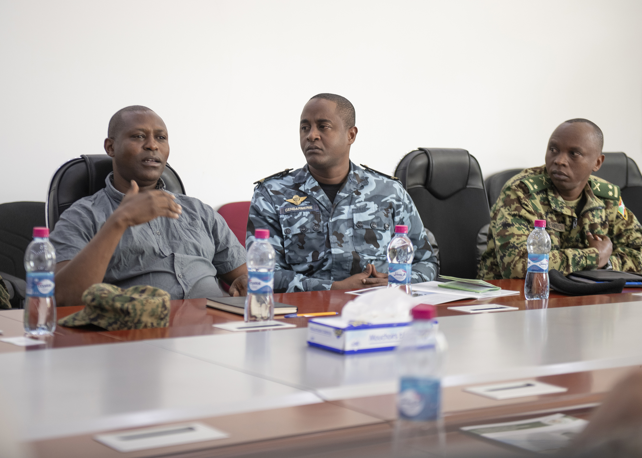 Dr. Simon Nyambura, director, Intergovernmental Authority on Development Center of Excellence for Preventing and Countering Violence Extremism, speaks during the first-ever formal meeting with foreign liaison officers and U.S. military members assigned to Combined Joint Task Force-Horn of Africa in Djibouti, Jan. 16, 2019. The purpose of the meeting was for both parties to familiarize themselves with each other's missions and goals through a short information exchange and set the stance for future meetings. (U.S. Air Force photo by Tech. Sgt. Shawn Nickel)