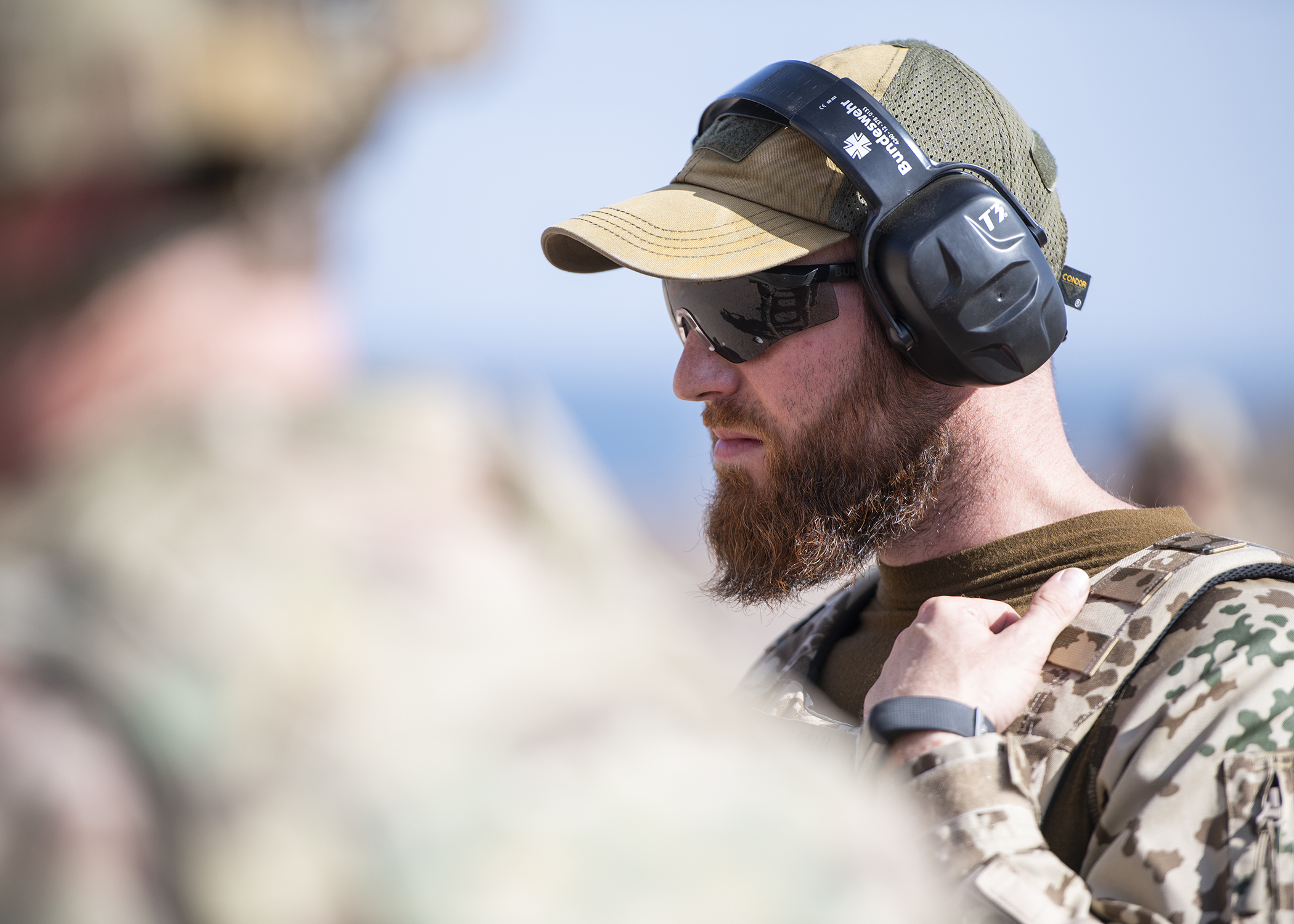 German Army Sgt. 1st Class Tobias Maul, information technology specialist and combat arms training instructor, assigned to Operation Atalanta, officiates the marksmanship portion of the German Armed Forces Badge for military proficiency at the Arta Range Complex, Djibouti, Jan. 17, 2019. Competing for the badge offered a unique opportunity to Soldiers and worked as an information exchange between the U.S. and Germany militaries. (U.S. Air Force photo by Tech. Sgt. Shawn Nickel)