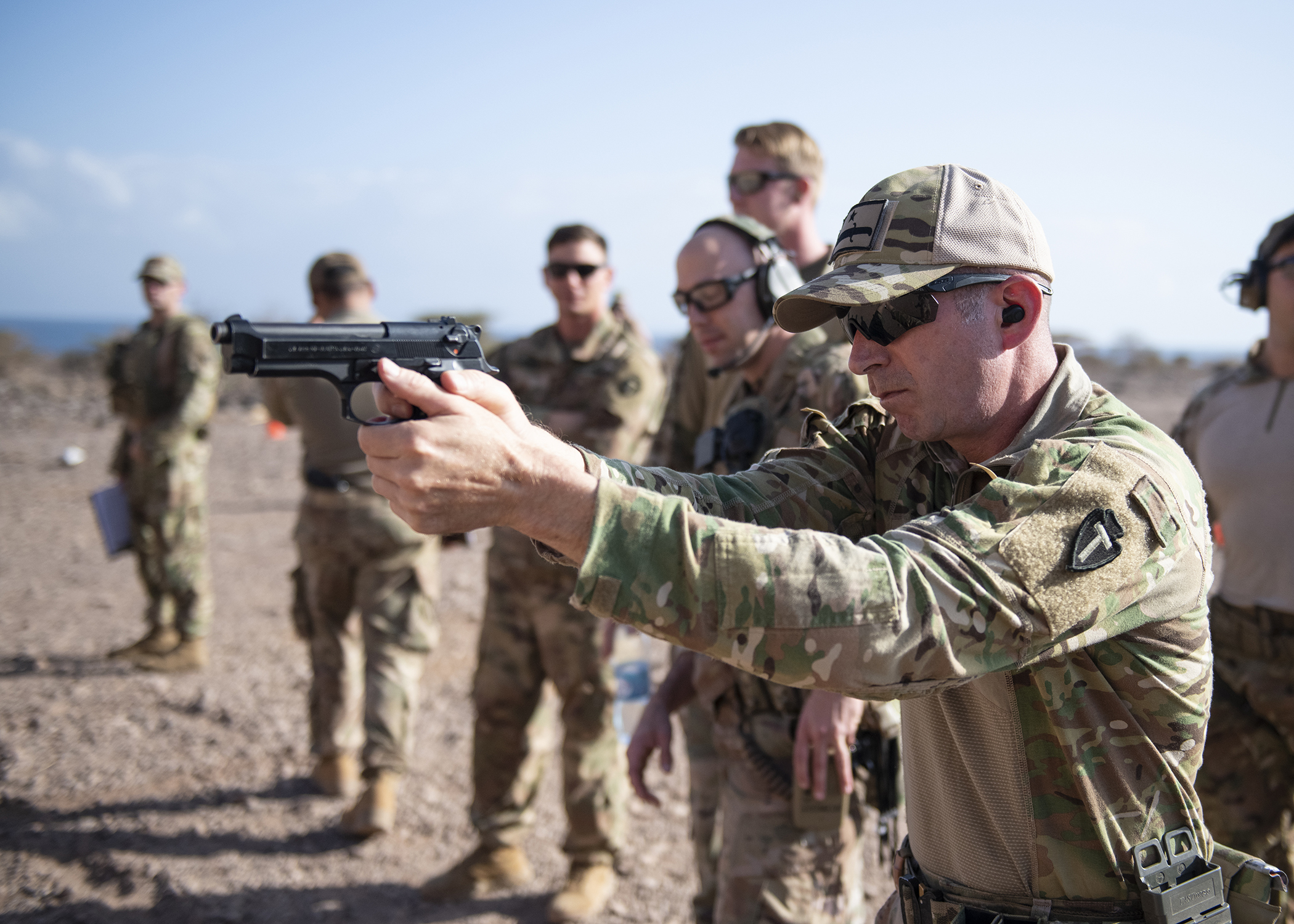 U.S. Army 1st Sgt. Jack Lamb, Bravo Company, 1-141 Infantry Regiment, Task Force Alamo, Texas National Guard, assigned to Combined Joint Task Force-Horn of Africa, practices before the official marksmanship portion of the German Armed Forces Badge for military proficiency at the Arta Range Complex, Djibouti, Jan. 17, 2019. Competing for the badge offered a unique opportunity to Soldiers and worked as an information exchange between the U.S. and Germany militaries. (U.S. Air Force photo by Tech. Sgt. Shawn Nickel)