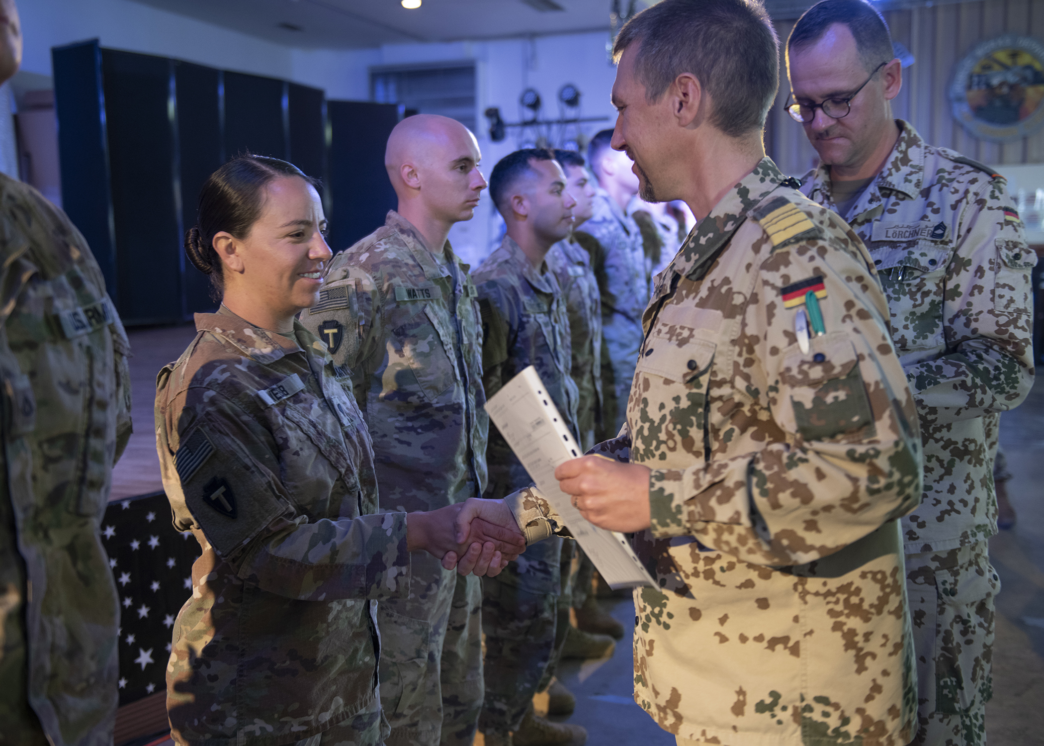 U.S. Army Spc. Natalia Webb, a medical technician from 1-141 Infantry Regiment, Task Force Alamo, Texas National Guard, assigned to Combined Joint Task Force-Horn of Africa, and the only female to earn the German Armed Forces Badge for military proficiency (GAFB) this rotation, accepter her GAFB at an awards ceremony at Camp Lemonnier, Djibouti, Jan. 22, 2019. Competing for the badge offered a unique opportunity to Soldiers and worked as an information exchange between the U.S. and Germany militaries. (U.S. Air Force photo by Tech. Sgt. Shawn Nickel)