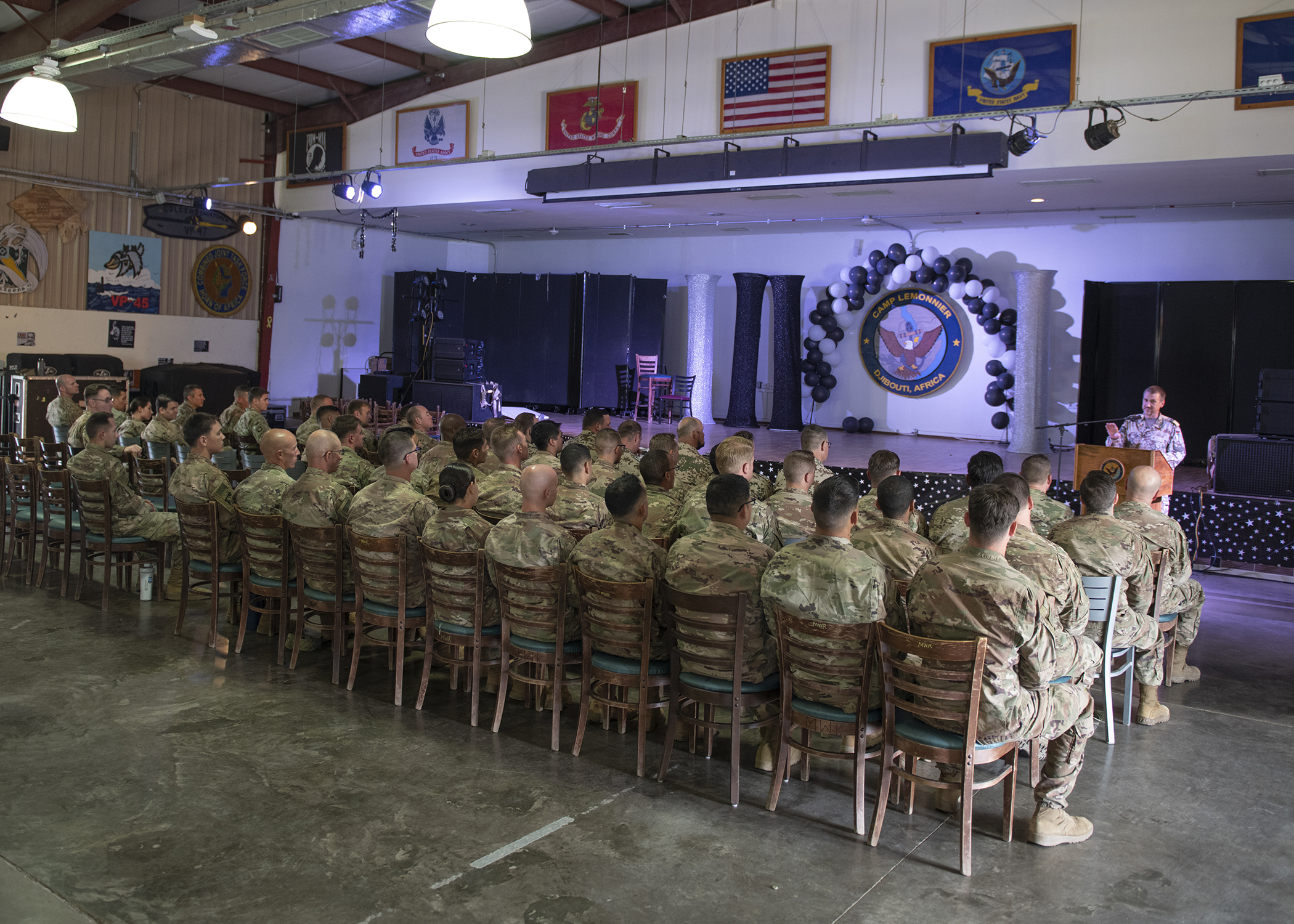 U.S. Army Soldier from 1-141 Infantry Regiment, Task Force Alamo, Texas National Guard, assigned to Combined Joint Task Force-Horn of Africa, and German Army and Navy service members gather for an awards presentation for the German Armed Forces Badge for military proficiency at the Camp Lemonnier, Djibouti, Jan. 22, 2019. Competing for the badge offered a unique opportunity to Soldiers and worked as an information exchange between the U.S. and Germany militaries. (U.S. Air Force photo by Tech. Sgt. Shawn Nickel)