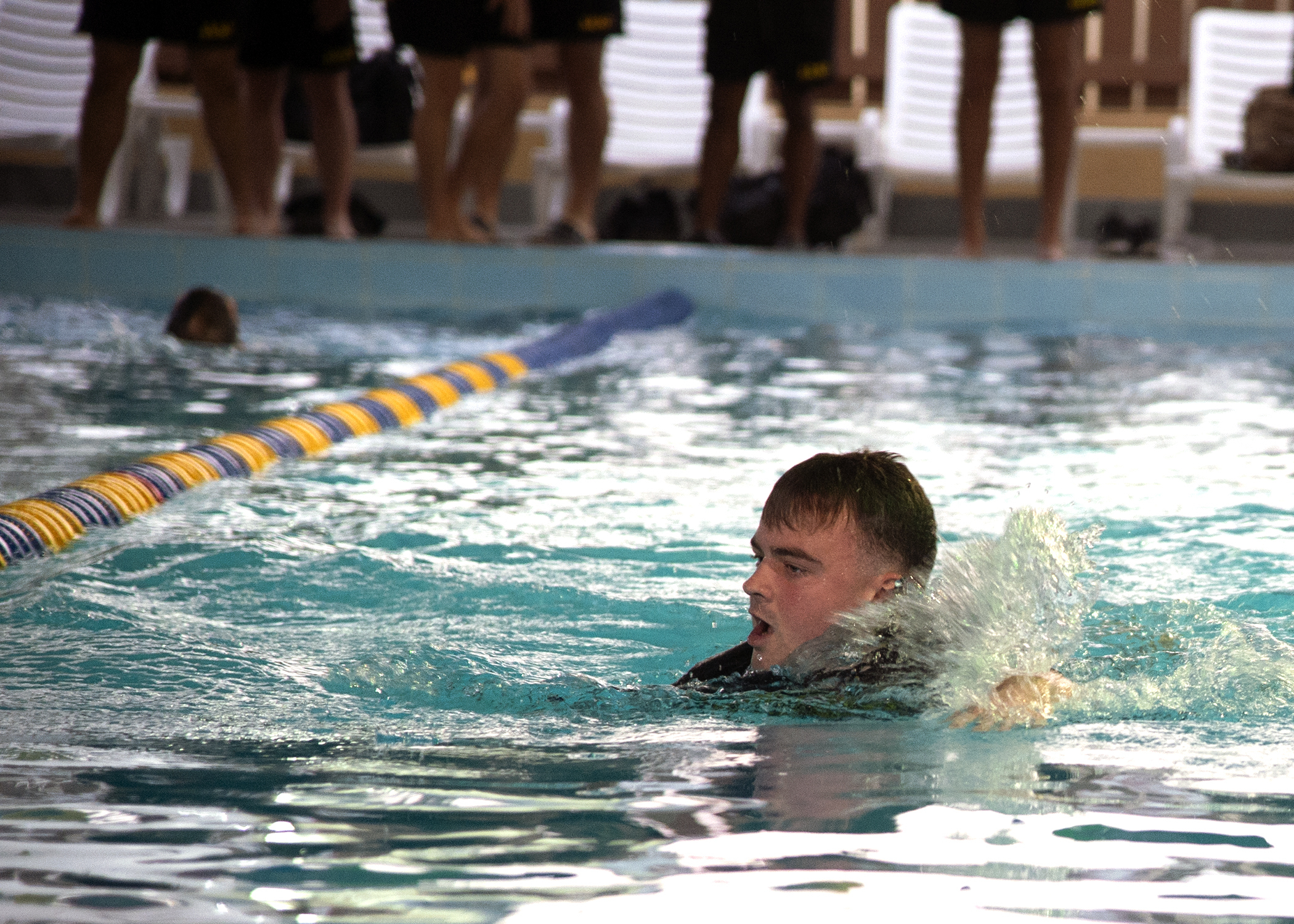 U.S. Army Spc. John Goldthorn, Headquarters and Headquarters Company, 1-141st Infantry Regiment, Task Force Alamo, Texas National Guard, assigned to Combined Joint Task Force-Horn of Africa (CJTF-HOA), Djibouti, competes in a swim competition for the German Armed Forces Badge (GAFB) for Military Proficiency in Djibouti, Jan. 16, 2019. The GAFB is awarded to and worn by German service members of all ranks. Allied service members may also be awarded the badge, subject to their nations' uniform regulations. (U.S. Navy photo by Mass Communication Specialist 1st Class Nick Scott)