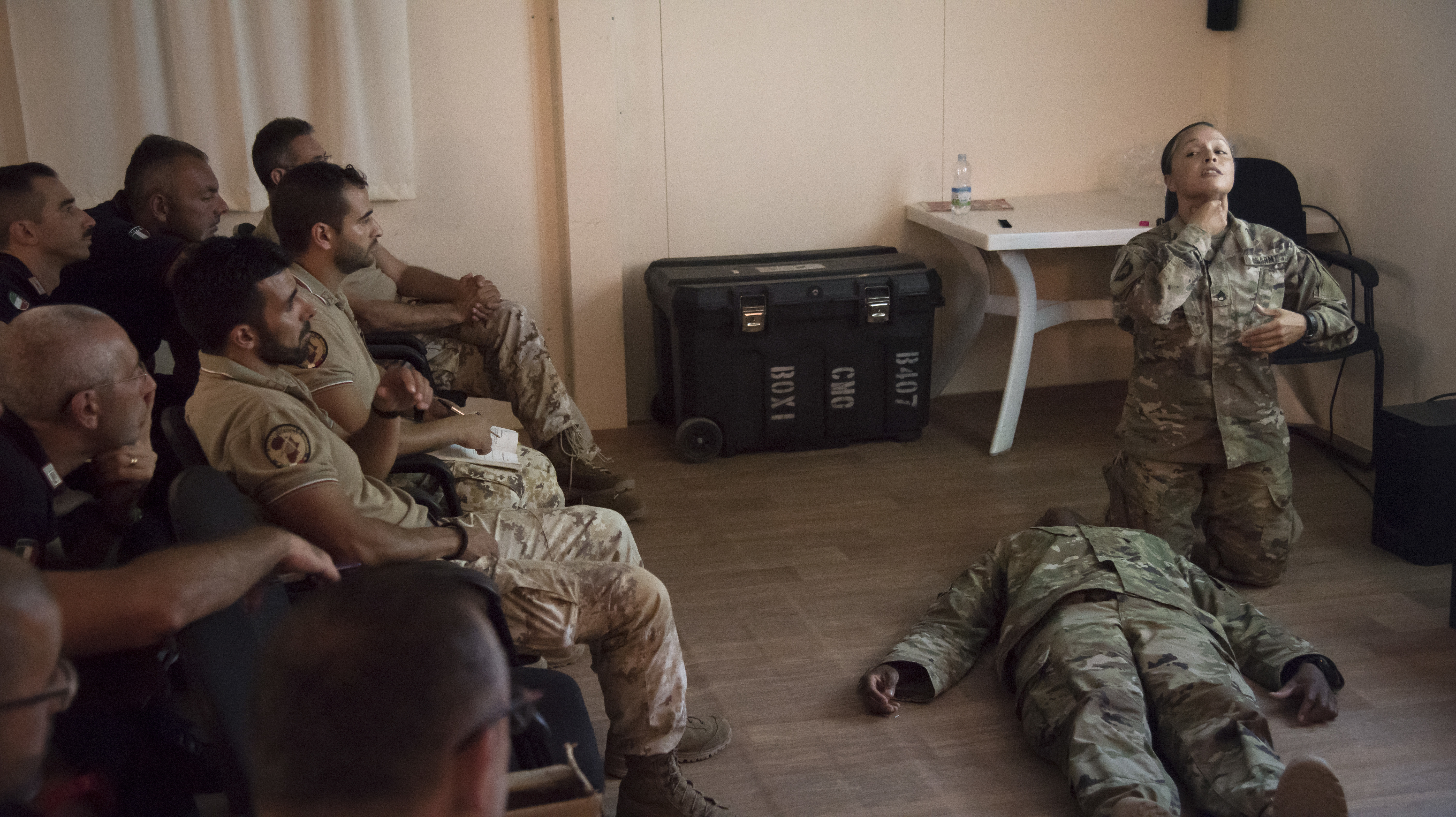 U.S. Army Staff Sgt. Carmen Lozano, a medic with the 403rd Civil Affairs (CA) Battalion Functional Specialty Team (FXSP), assigned to Combined Joint Task Force-Horn of Africa, leads a lesson on airway management for Italian military students at Base Militar Italiano de Supporte, Jan. 15, 2019. Airway management is a primary focus of the Combat Lifesaver Course, conducted for members of the Italian military and Carabinieri by medics from the 403rd CA FXSP. (U.S. Air Force photo by Senior Airman Kirsten Brandes)