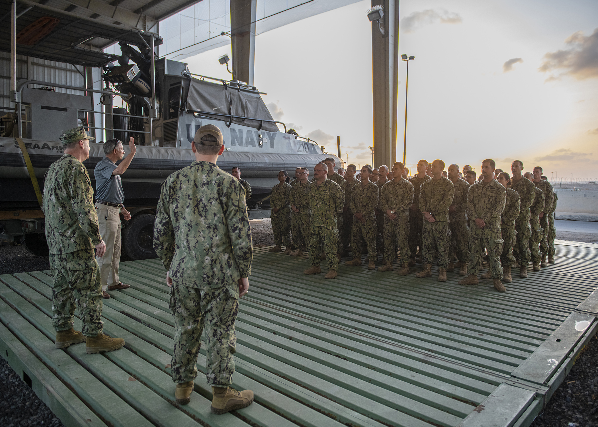 Assistant Secretary of the Navy (Manpower and Reserve Affairs) and retired Rear Adm. Gregory J. Slavonic, left, and Chief of Navy Reserve Vice Adm. Luke McCollum speak to Sailors from Coastal Riverine Squadron 11, assigned to Combined Joint Task Force - Horn of Africa, while visiting Camp Lemonnier, Djibouti, Feb. 3, 2019. Slavonic and McCollum visited as part of a tour of Reserve units to answer questions, discuss leadership initiatives and interact with local Sailors. (U.S. Air Force photo by Tech. Sgt. Shawn Nickel)
