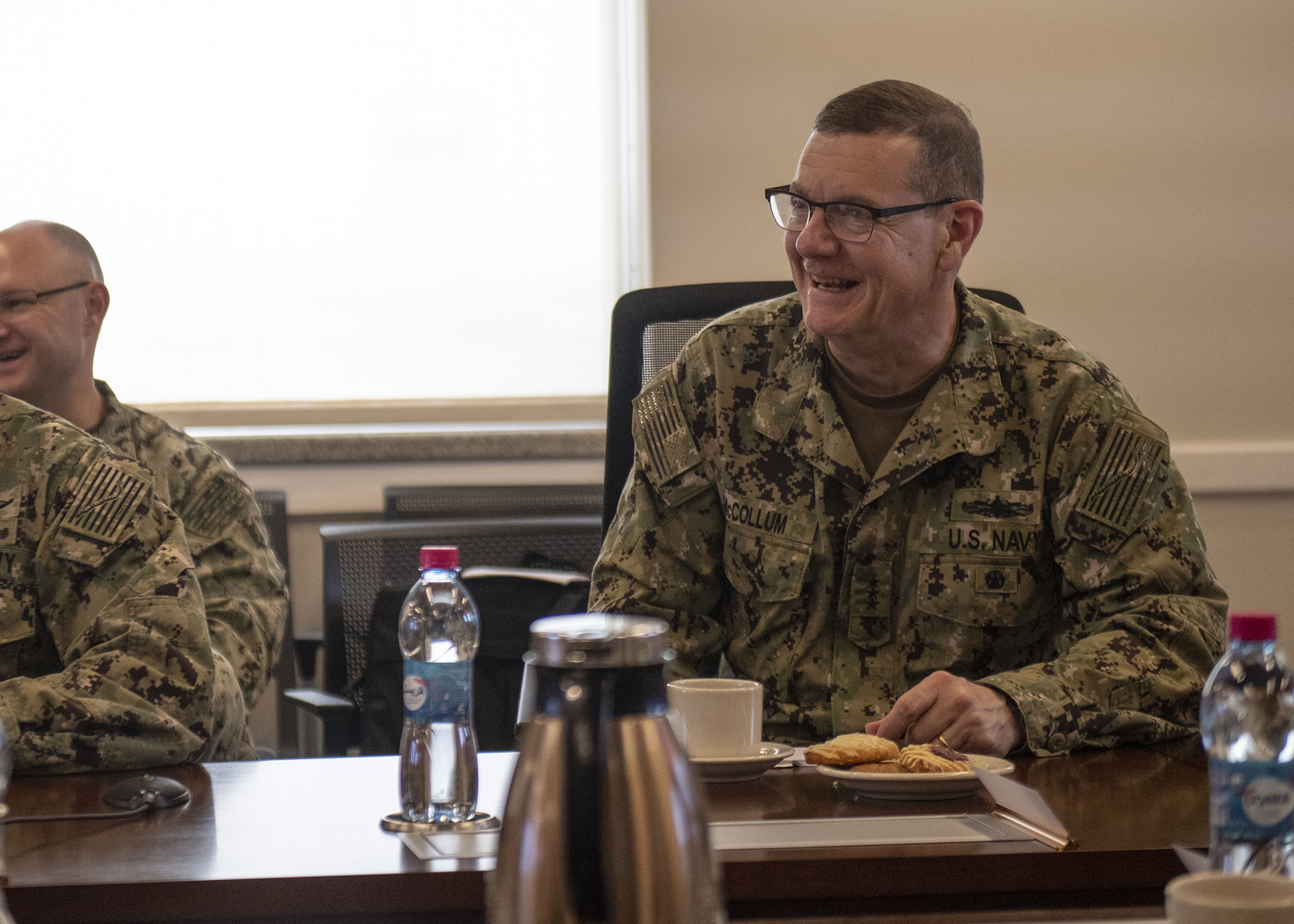 Chief of Navy Reserve Vice Adm. Luke McCollum laughs during a meeting with Combined Joint Task Force - Horn of Africa leadership during a unit mission brief about operations in the Horn of Africa while visiting Camp Lemonnier, Djibouti, Feb. 3, 2019. McCollum visited as part of a tour of Reserve units to answer questions, discuss leadership initiatives and interact with local Sailors. (U.S. Air Force photo by Tech. Sgt. Shawn Nickel)