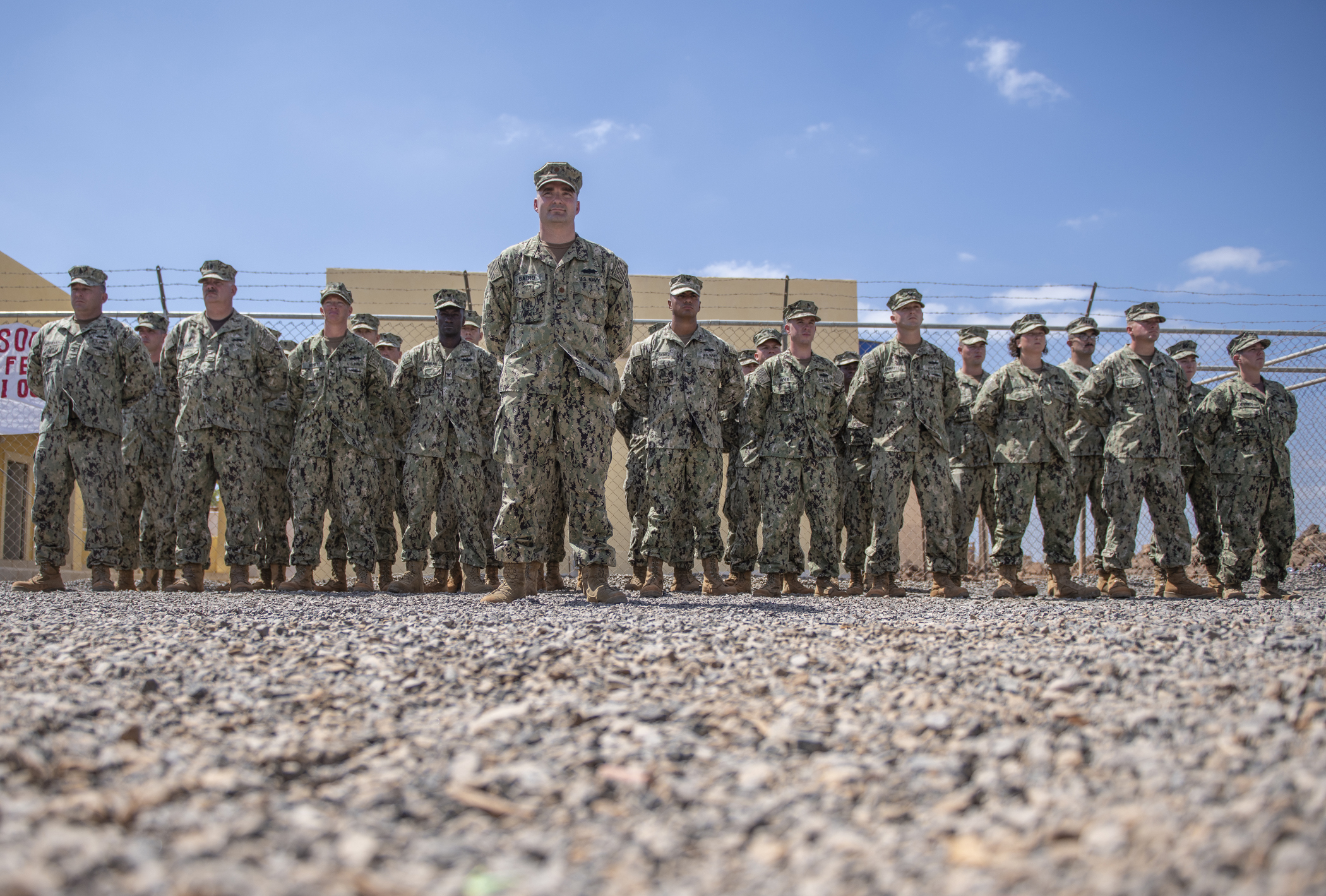 U.S. Navy Seabees from Naval Mobile Construction Battalion 1, assigned to Combined Joint Task Force-Horn of Africa, stand in formation during the Ali Oune Medical Clinic ribbon cutting ceremony in Ali Oune, Djibouti, Jan. 31, 2019. The clinic, which the Seabees have worked on for five months, is intended to enhance the Ministry of Health for Djibouti's ability to provide basic medical, birth and after care to the Ali Oune village and its more than 1,000 residents and rural neighbors. (U.S. Air Force photo by Tech. Sgt. Shawn Nickel)