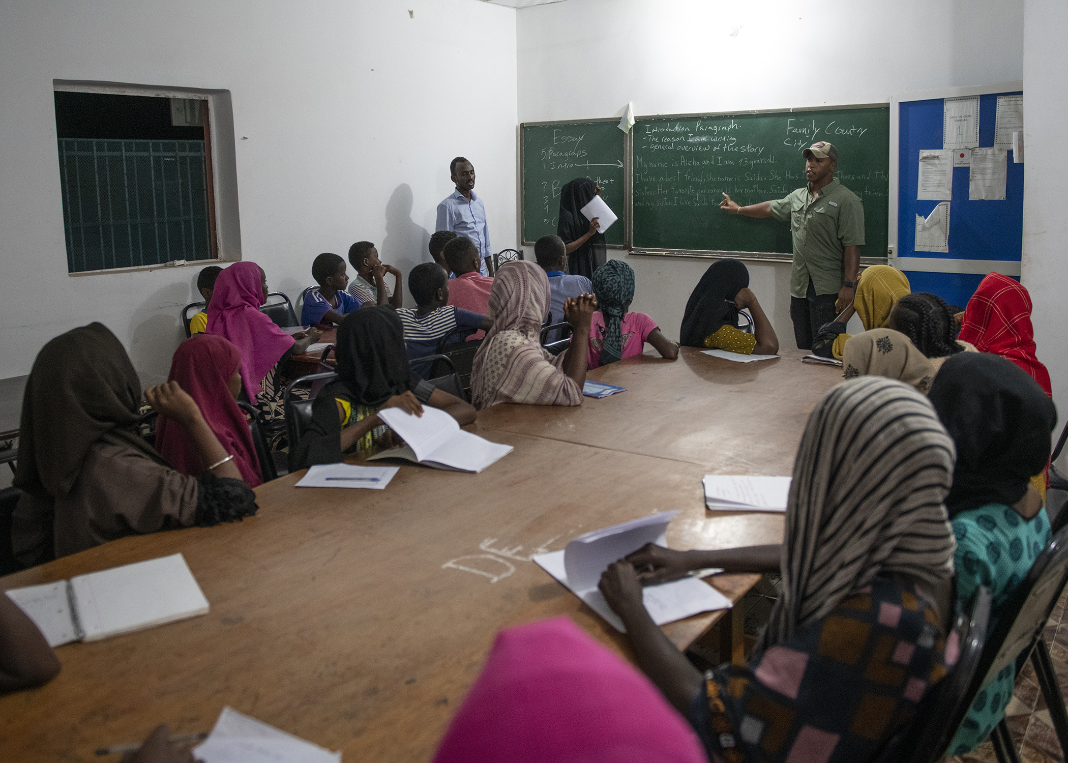 U.S. Army Staff Sgt. Willie Linson, the senior medic for 404th Civil Affairs Battalion, leads an English Discussion Group in Tadjourah, Djibouti, Feb. 12, 2019. More than 90 Djiboutian youth and adults attended the group where students develop practical linguistic and rhetorical skills through conversation with English-speaking U.S. service members. (U.S. Air Force photo by Tech. Sgt. Shawn Nickel)