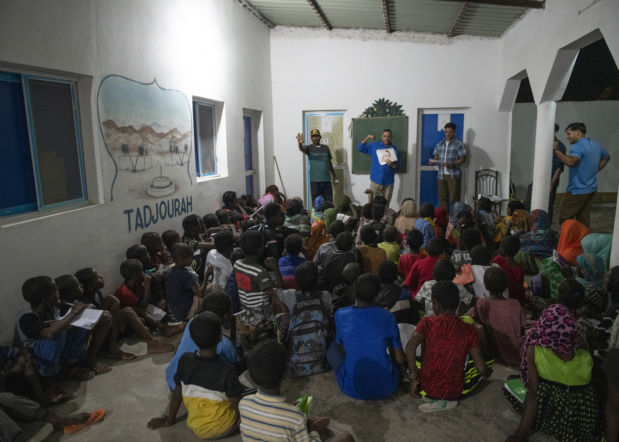 Children participate during an English Discussion Group led by U.S. Army Soldiers from the 404th Civil Affairs Battalion, assigned to Combined Joint Task Force-Horn of Africa in Tadjourah, Djibouti, Feb. 12, 2019. More than 90 Djiboutian youth and adults attended the group where students develop practical linguistic and rhetorical skills through conversation with English-speaking U.S. service members. (U.S. Air Force photo by Tech. Sgt. Shawn Nickel)
