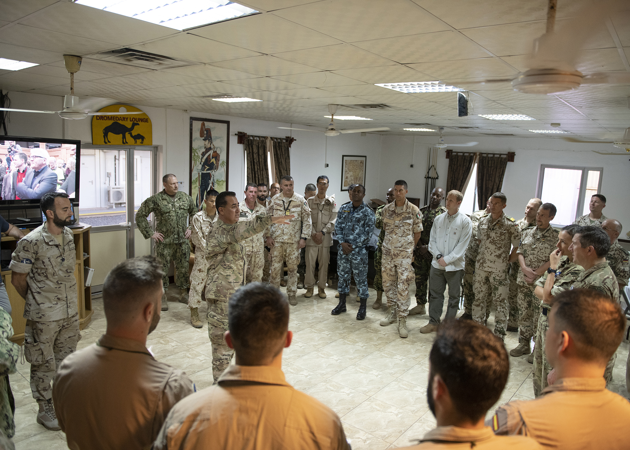 Multinational military partners gather for opening remarks during a cultural exchange event at Camp Lemonnier, Djibouti, Feb. 27, 2019. Multinational military partners affiliated with Camp Lemonnier hold monthly exchange events to strengthen alliances and attract new partners in the combined joint military environment. (U.S. Air Force photo by Tech. Sgt. Shawn Nickel)