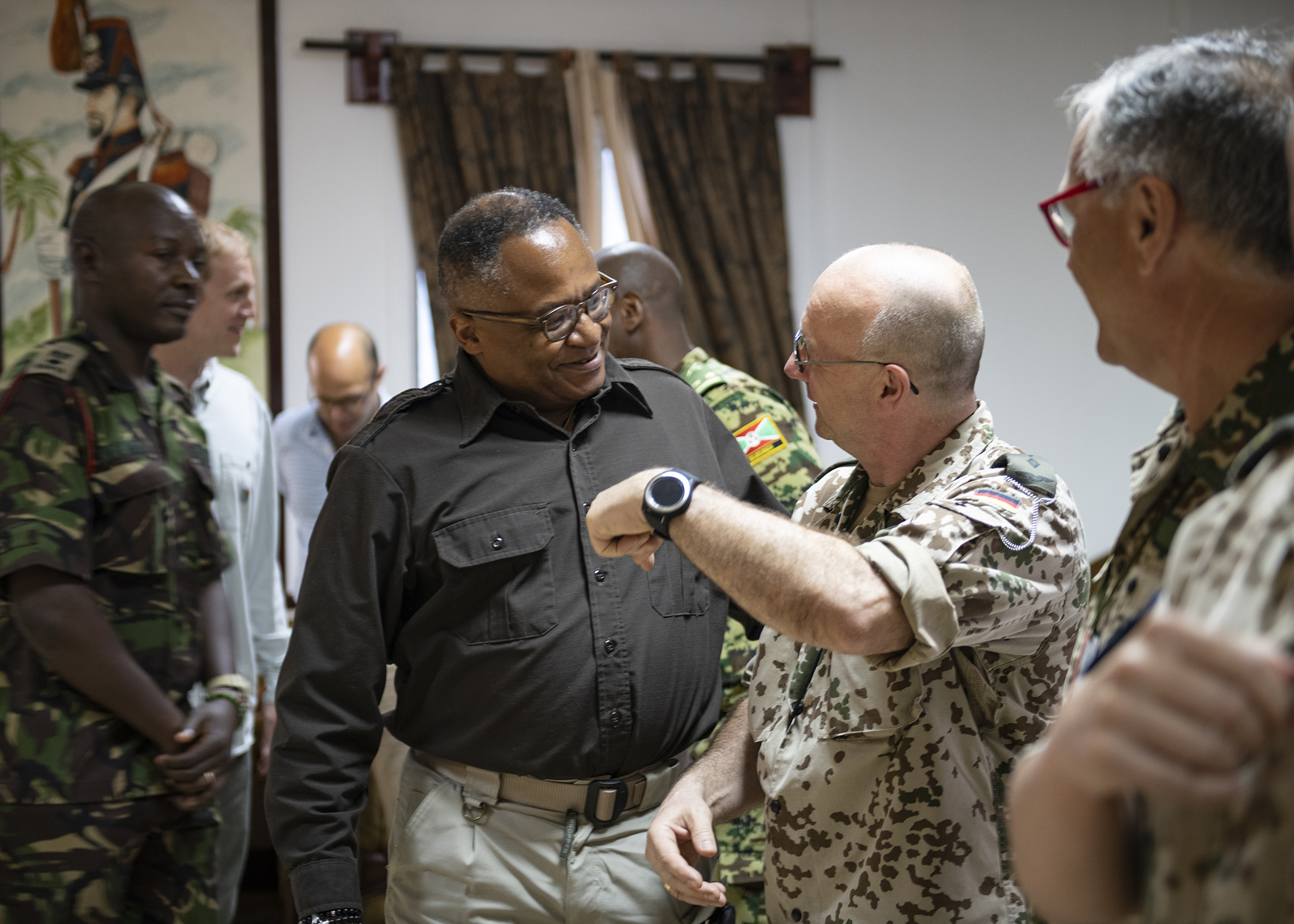 Irvin Hicks Jr., foreign policy advisor (POLAD) for Combined Joint Task Force-Horn of Africa, greets multinational military partners during a cultural exchange event at Camp Lemonnier, Djibouti, Feb. 27, 2019. Multinational military partners affiliated with Camp Lemonnier hold monthly exchange events to strengthen alliances and attract new partners in the combined joint military environment. (U.S. Air Force photo by Tech. Sgt. Shawn Nickel)