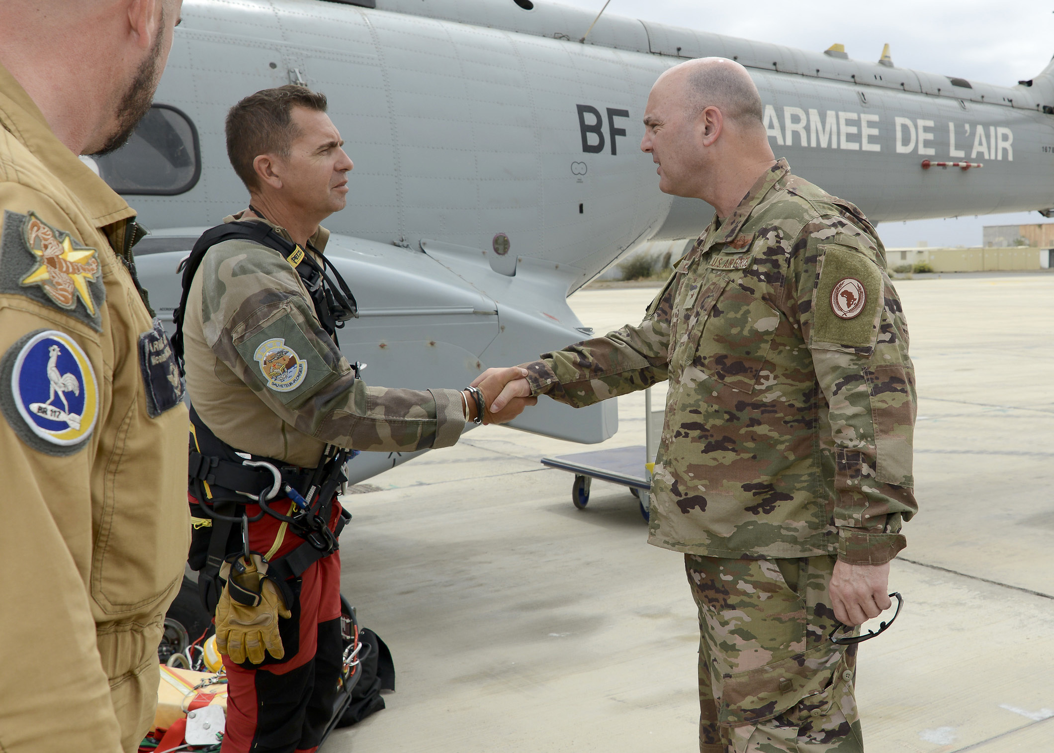 French air force Chief Master Sgt. Franck (left), rescue team NCO, greets U.S. Air Force Brig. Gen. James R. Kriesel, deputy commanding general of Combined Joint Task Force-Horn of Africa (CJTF-HOA), during his visit to French Air Force Base 188, Djibouti, Feb. 19, 2019. Kriesel visited the French base to gain insight into their assets and capabilities as a U.S. ally in CJTF-HOA's combined joint operations area. (Courtesy Photo)