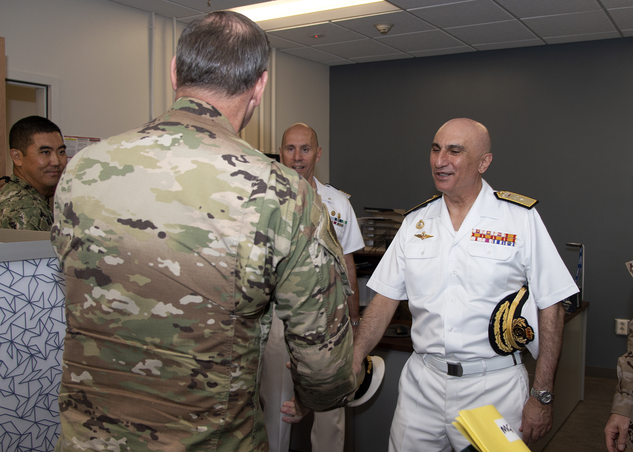 U.S. Army Maj. Gen. James D. Craig, left, commanding general, Combined Joint Task Force-Horn of Africa (CJTF-HOA), shakes hands with Spanish Navy Rear Adm. Ricardo A. Hernández, force commander, European Union Naval Force ATALANTA, at Camp Lemonnier, Djibouti, March 8, 2019. Hernández visited CJTF-HOA during a theater turnover with European Union partners. (U.S. Navy photo by Mass Communication Specialist 1st Class Nick Scott)