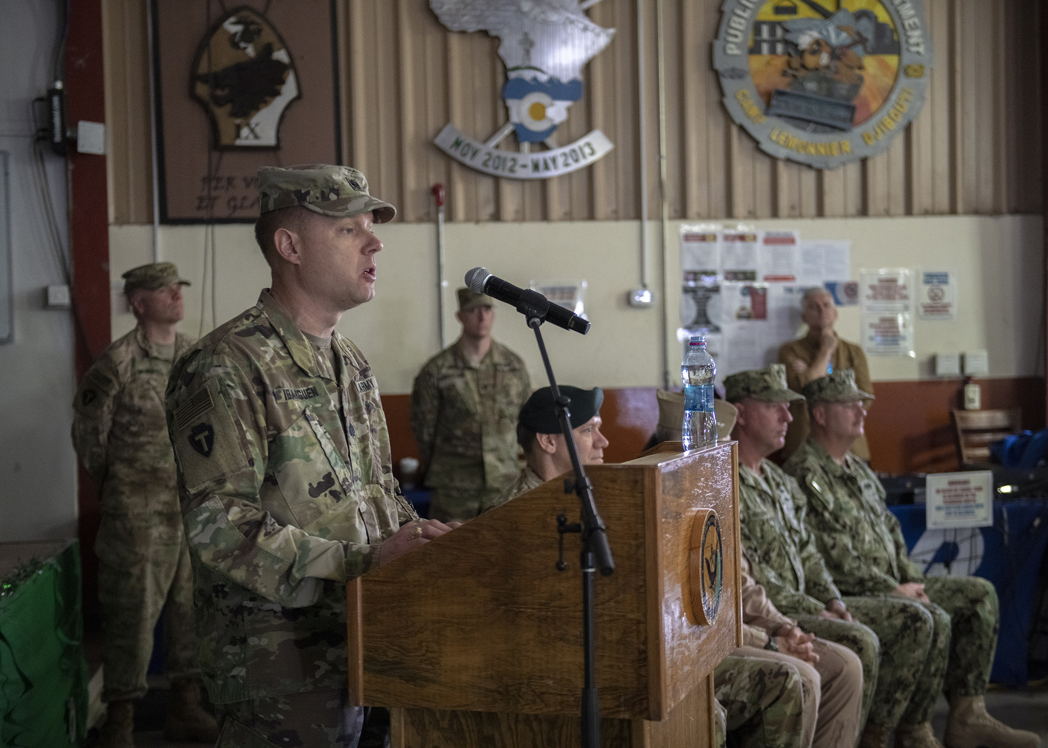 U.S. Army Lt. Col. Sean Ibarguen, commander, 1st Battalion, 141st Infantry Regiment, Task Force Alamo, Texas National Guard, gives a speech while transferring his unit's mission at Combined Joint Task Force-Horn of Africa (CJTF-HOA) to 2nd Battalion, 113th Infantry Regiment, Task Force Warrior, New Jersey National Guard, during a transfer of authority ceremony at Camp Lemonnier, Djibouti, March 15, 2019. Task Force Warrior assumed responsibility as the security forces battalion for CJTF-HOA and will also contribute to international efforts to enhance security and stability in East Africa. (U.S. Air Force Photo by Tech. Sgt. Shawn Nickel)