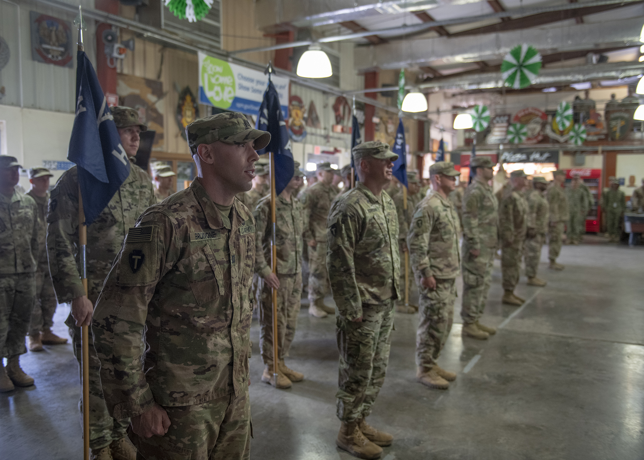 U.S. Army Soldiers from 1st Battalion, 141st Infantry Regiment, Task Force Alamo, Texas National Guard, stand at attention during a transfer of authority ceremony at Camp Lemonnier, Djibouti, March 15, 2019. The 2nd Battalion, 113th Infantry Regiment, Task Force Warrior, New Jersey National Guard, assumed responsibility as the security forces battalion for Combined Joint Task Force-Horn of Africa and will also contribute to international efforts to enhance security and stability in East Africa. (U.S. Air Force Photo by Tech. Sgt. Shawn Nickel)