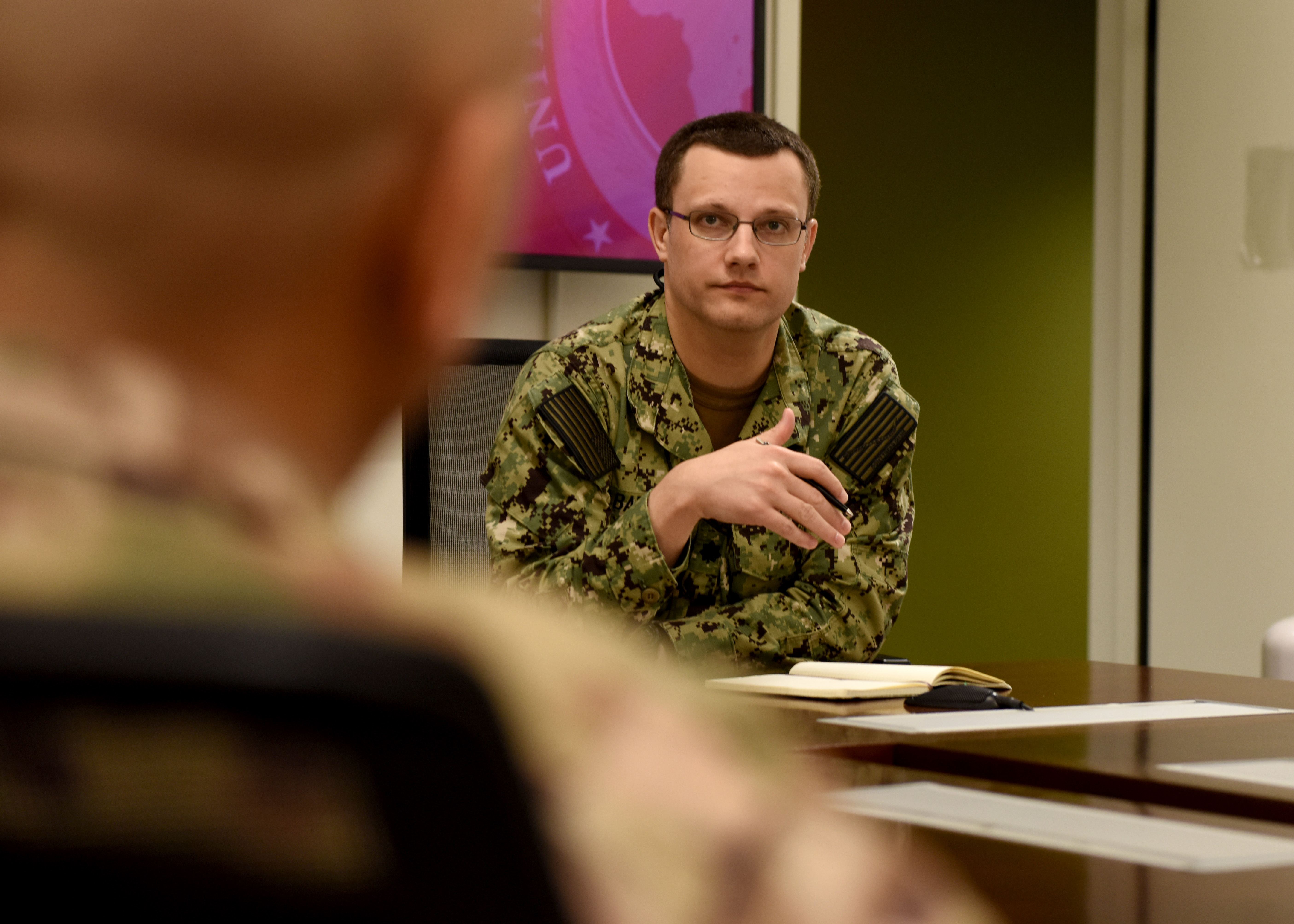 U.S. Navy Cmdr. Kevin Barnes, future operations director assigned to Combined Joint Task Force-Horn of Africa (CJTF-HOA), listens the CJTF-HOA operational planning team during a briefing for the U.S. Department of Defense's relief effort in the Republic of Mozambique and surrounding areas following Cyclone Idai at Camp Lemonnier, Djibouti, March 27, 2019. Teams from CJTF-HOA, which is leading DoD relief efforts, began immediate preparation to respond following a call for assistance from the U.S. Agency for International Development's Disaster Assistance Response Team. (U.S. Air Force photo by Staff Sgt. Franklin R. Ramos)