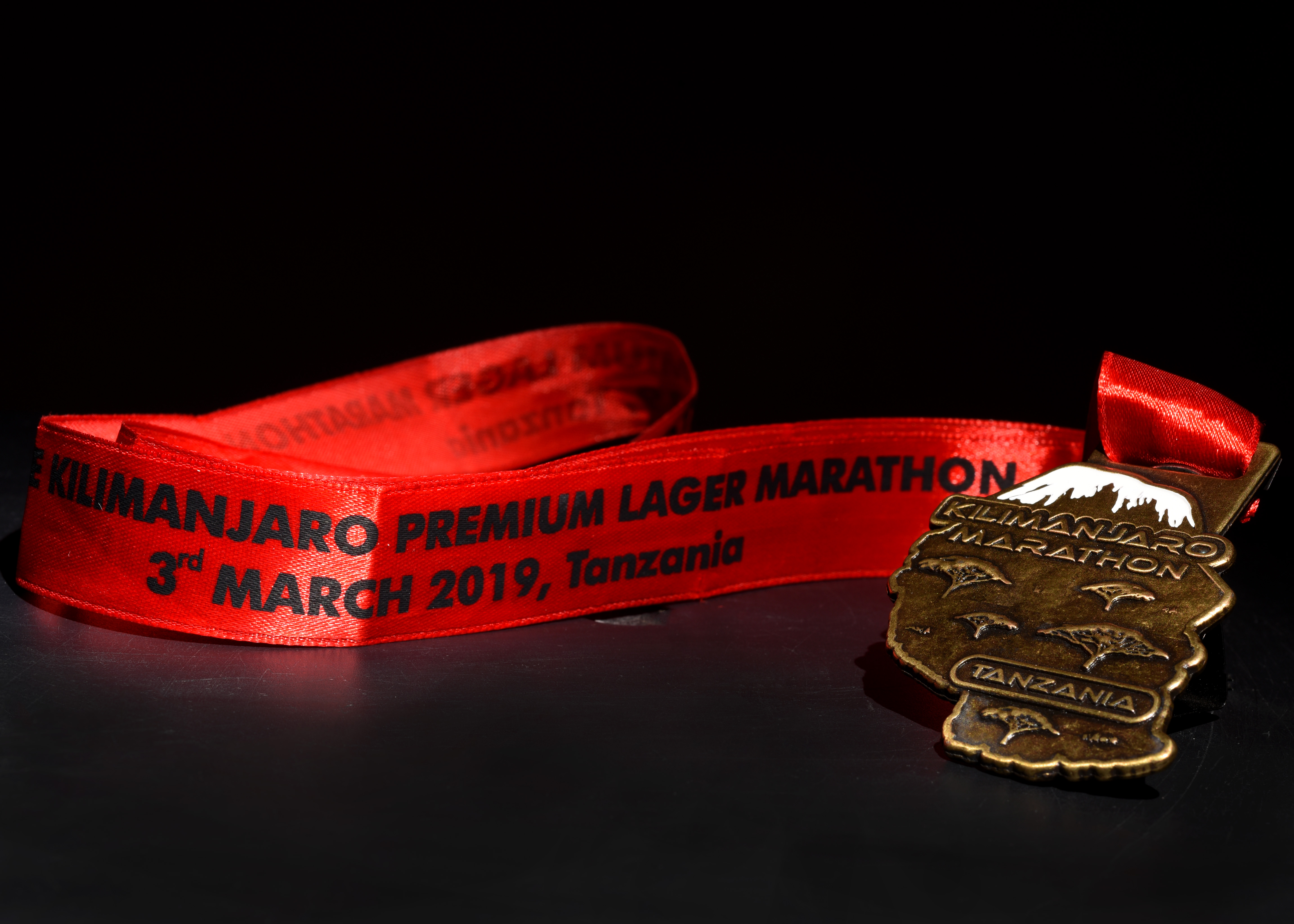 A Kilimanjaro Marathon medal belonging to U.S. Army Capt. David Picchi, contingency contracting officer assigned to Combined Joint Task Force-Horn of Africa, is displayed at Camp Lemonnier, Djibouti, March 21, 2019. Picchi, a member of the Illinois Army National Guard Running Team, deployed from Camp Lincoln, Springfield, Illinois, earned the medal when he completed the 42.2-kilometer marathon in 5 hours, 15 minutes in Moshi, Tanzania, March 3, 2019. (U.S. Air Force photo by Staff Sgt. Franklin R. Ramos)