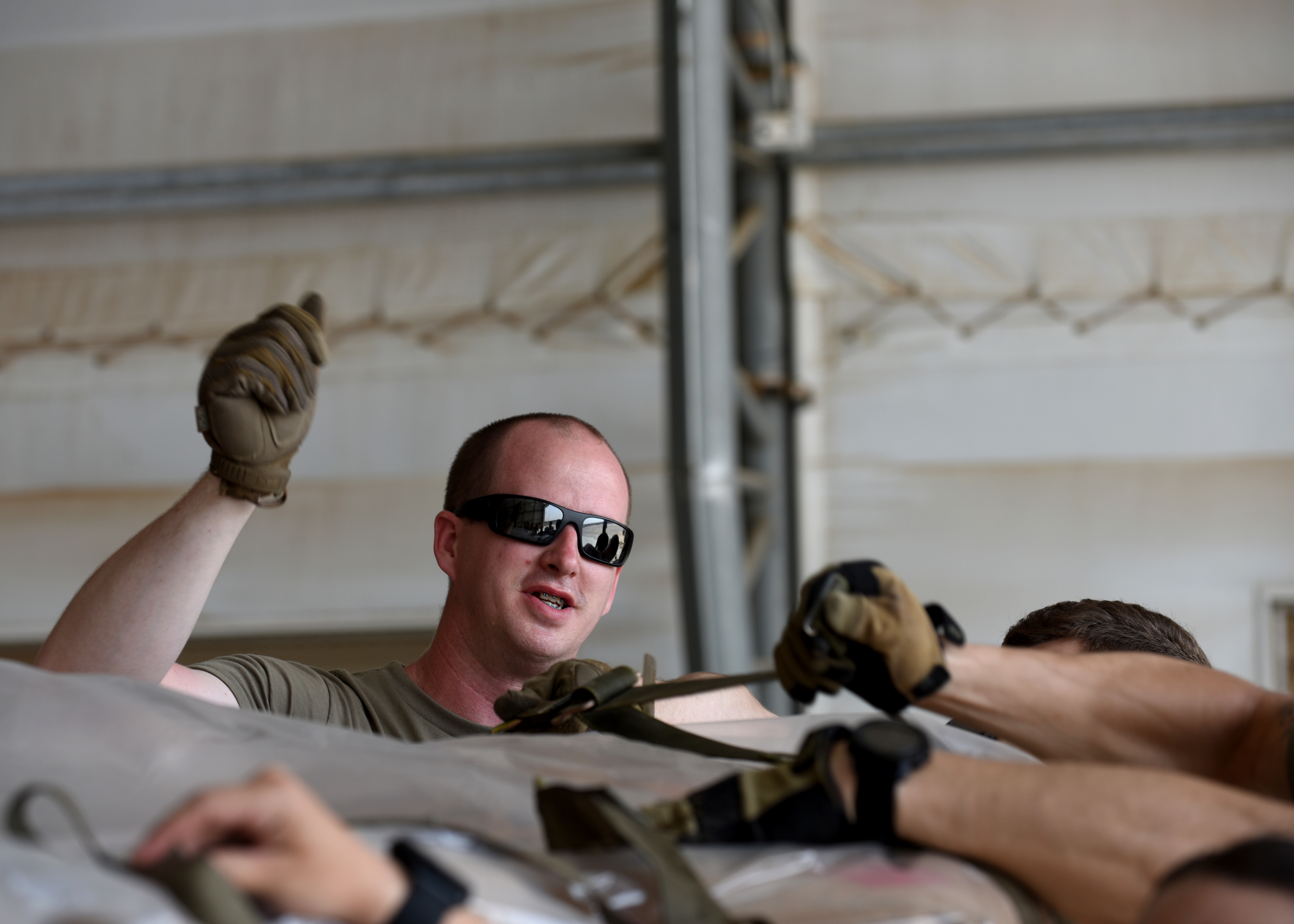 U.S. Air Force Staff Sgt. Alan Wells, mobile aerial port supervisor for the 435th Contingency Response Group, Ramstein Air Base, Germany, currently at Camp Lemonnier, Djibouti, supporting Combined Joint Task Force-Horn of Africa (CJTF-HOA), ties U.S. Agency for International Development (USAID) food supplies onto a cargo pallet at Camp Lemonnier, April 1, 2019, for the U.S. Department of Defense's (DoD) humanitarian relief effort in the Republic of Mozambique and surrounding areas following Cyclone Idai. Teams supporting CJTF-HOA, which is leading the DoD relief effort, prepared cargo for transport following a call for assistance from the USAID Disaster Assistance Response Team. (U.S. Air Force photo by Staff Sgt. Franklin R. Ramos)