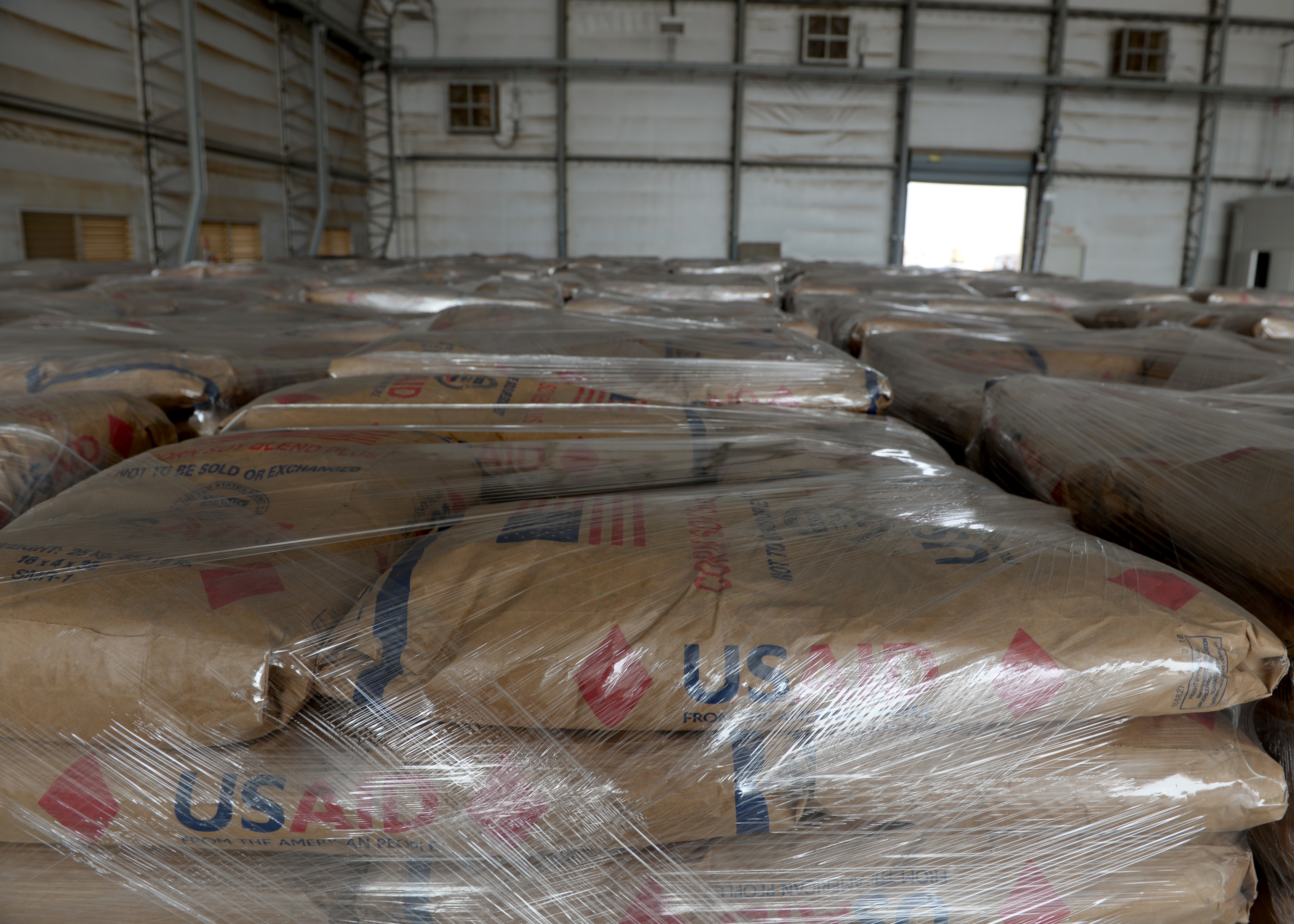 U.S. Agency for International Development (USAID) food pallets sit inside a hangar at Camp Lemonnier, Djibouti, April 1, 2019, for the U.S. Department of Defense's (DoD) relief effort in the Republic of Mozambique and surrounding areas following Cyclone Idai. Members from the 435th Contingency Response Group, Ramstein Air Base, Germany, currently at Camp Lemonnier supporting Combined Joint Task Force-Horn of Africa, which is leading the DoD humanitarian relief effort, prepared the cargo for transport following a call for assistance from the USAID Disaster Assistance Response Team. (U.S. Air Force photo by Staff Sgt. Franklin R. Ramos)