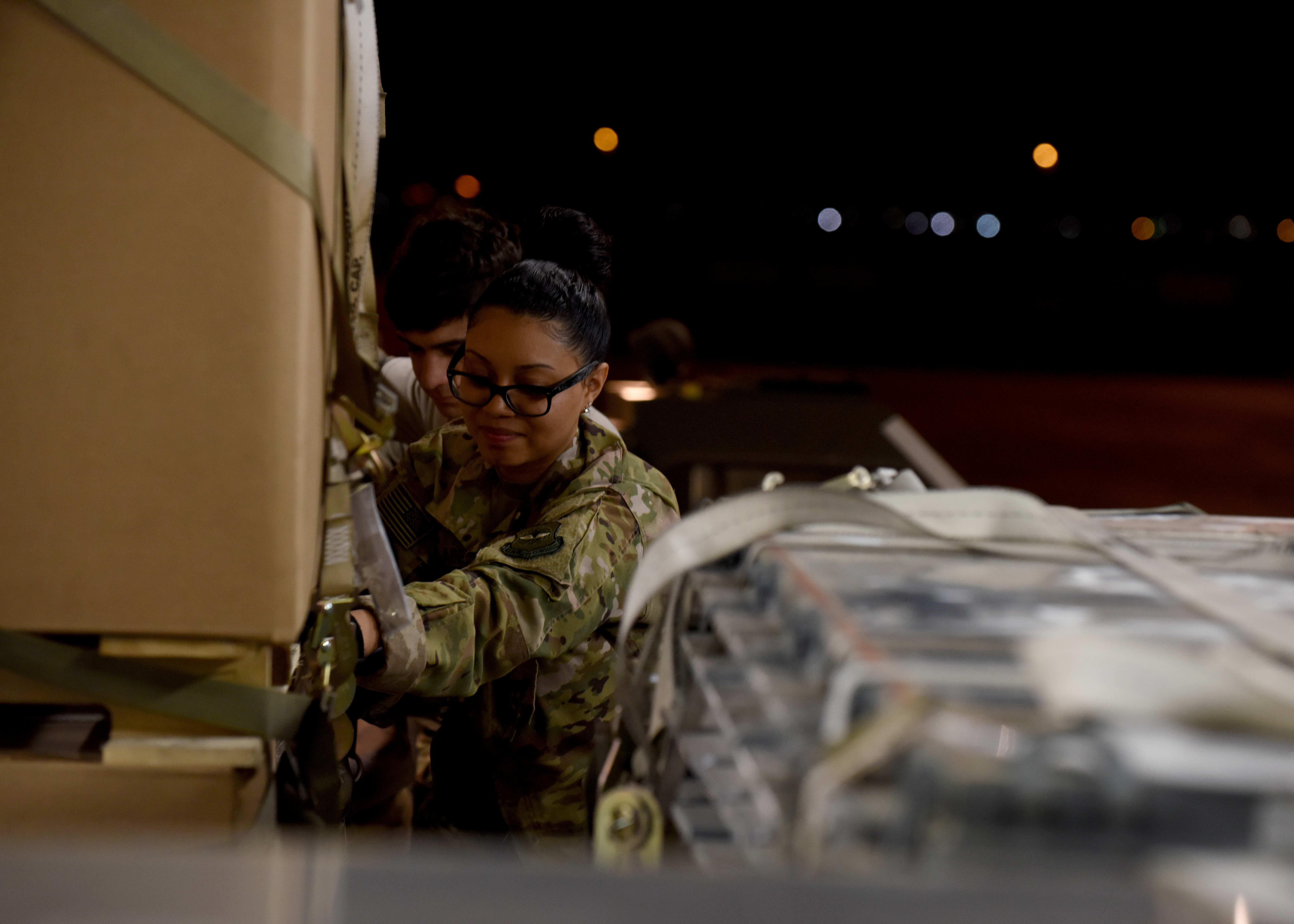 U.S. Air Force Airman 1st Class Kyra Blades, a loadmaster from the 16th Airlift Squadron, Joint Base Charleston, South Carolina, supporting Combined Joint Task Force-Horn of Africa (CJTF-HOA), shifts cargo inside a U.S. Air Force C-17 Globemaster III to create space for U.S. Agency for International Development (USAID) supplies at Camp Lemonnier, Djibouti, April 2, 2019, for the U.S. Department of Defense's (DoD) humanitarian relief effort in the Republic of Mozambique and surrounding areas following Cyclone Idai. CJTF-HOA, which is leading the DoD relief effort, transported 17,400 pounds of USAID food, a forklift, a 25K loader and palletizing equipment on the C-17 to Mozambique following a call for assistance from the USAID Disaster Assistance Response Team. (U.S. Air Force photo by Staff Sgt. Franklin R. Ramos)