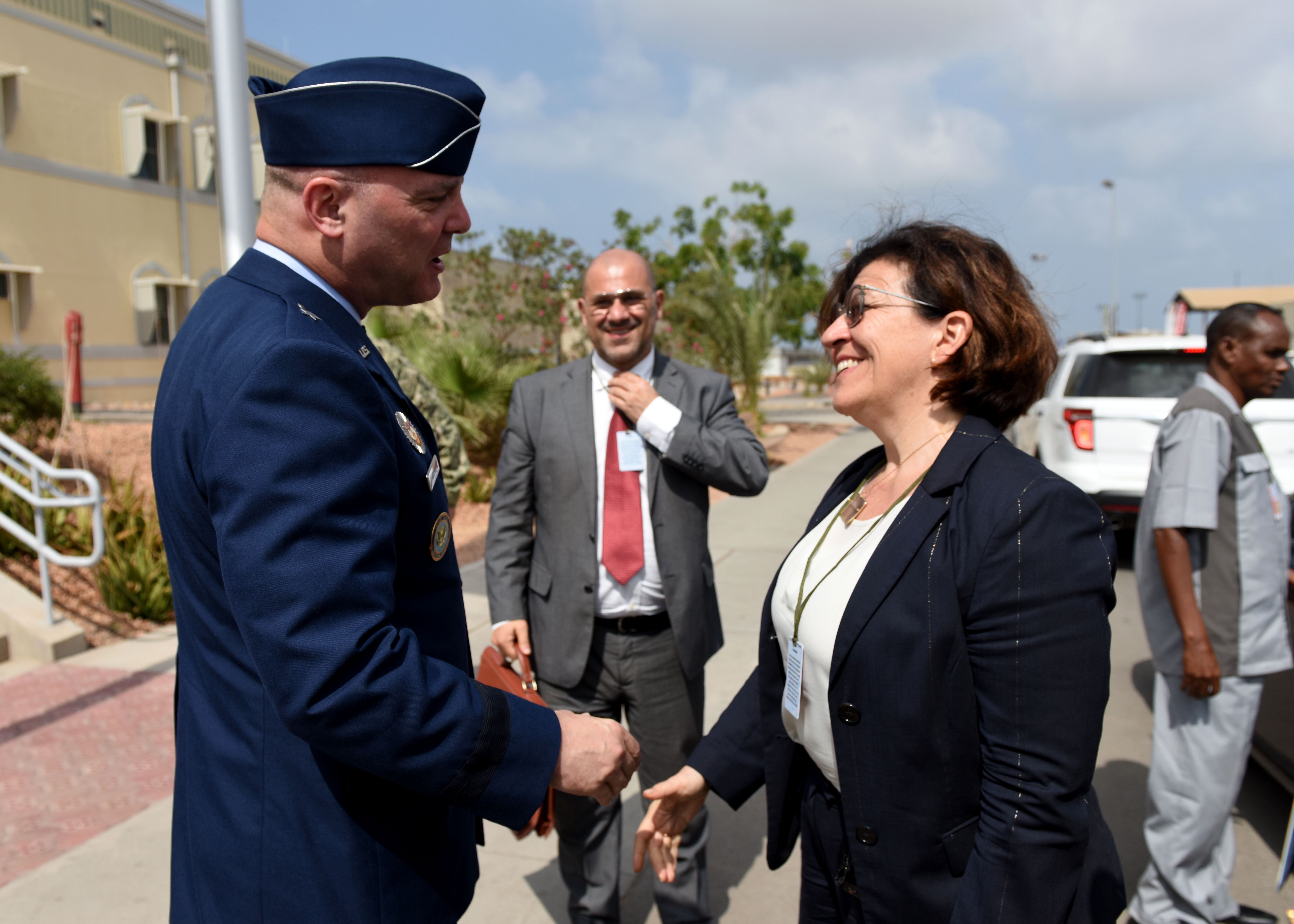 U.S. Air Force Brig. Gen. James R. Kriesel, left, deputy commanding general of Combined Joint Task Force-Horn of Africa (CJTF-HOA), greets Elisabetta Trenta, Italian Minister of Defense, during her visit to Camp Lemonnier, Djibouti, April 9, 2019. Trenta visited CJTF-HOA to gain insight on how U.S. forces operate in the combined joint operations area and to foster relations. (U.S. Air Force Photo by Staff Sgt. Franklin R. Ramos)