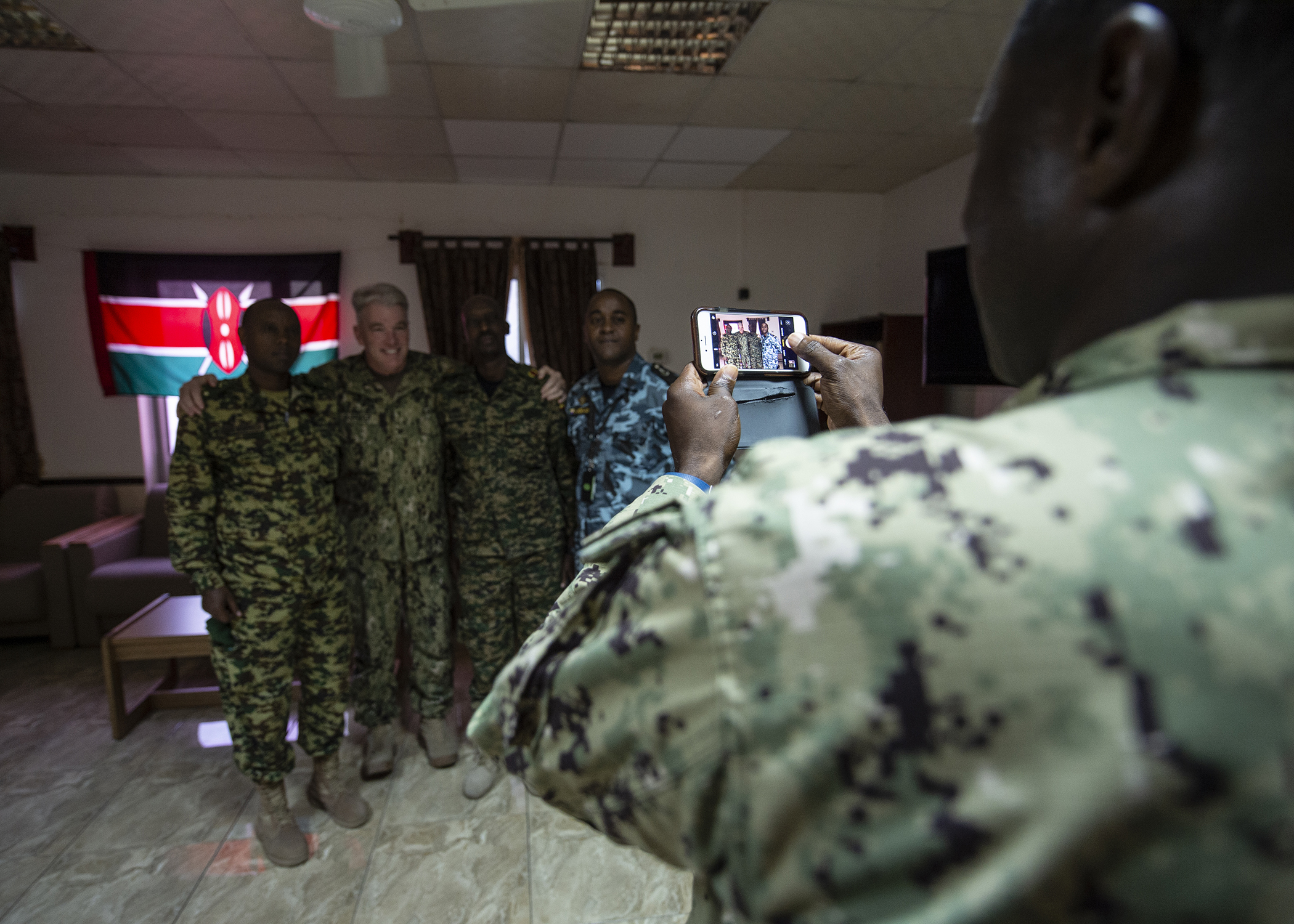 U.S. Navy Capt. Robert Carpenter, middle left, the command chaplain for Combined Joint Task Force-Horn of Africa (CJTF-HOA), poses for a photo with multinational military partners while attending a cultural exchange event at Camp Lemonnier, Djibouti, March 27, 2019. CJTF-HOA holds monthly exchange events with multinational military partners affiliated with Camp Lemonnier to strengthen alliances and attract new partners in the combined joint military environment. (U.S. Air Force photo by Tech. Sgt. Shawn Nickel)