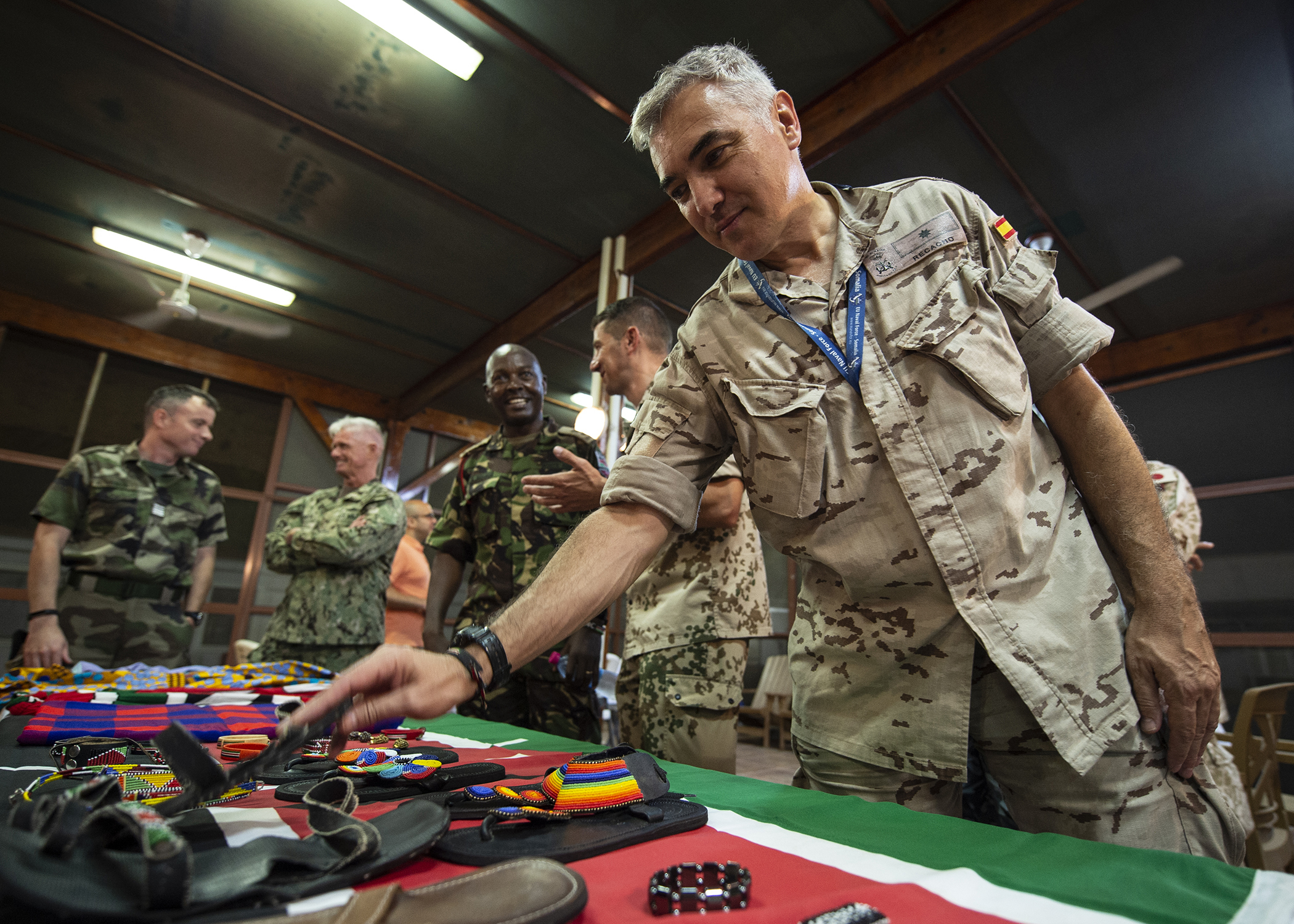 Multinational military partners look at memorabilia from Kenya while attending a Combined Joint Task Force-Horn of Africa (CJTF-HOA) cultural exchange event at Camp Lemonnier, Djibouti, March 27, 2019. CJTF-HOA holds monthly exchange events with multinational military partners affiliated with Camp Lemonnier to strengthen alliances and attract new partners in the combined joint military environment. (U.S. Air Force photo by Tech. Sgt. Shawn Nickel)