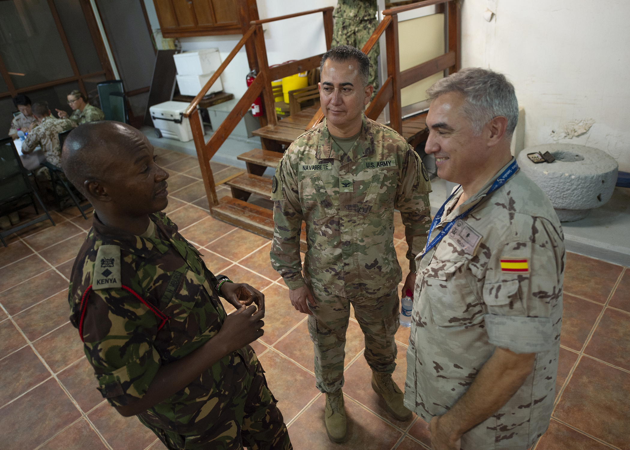 Multinational military partners talk while attending a Combined Joint Task Force-Horn of Africa (CJTF-HOA) cultural exchange event at Camp Lemonnier, Djibouti, March 27, 2019. CJTF-HOA holds monthly exchange events with multinational military partners affiliated with Camp Lemonnier to strengthen alliances and attract new partners in the combined joint military environment. (U.S. Air Force photo by Tech. Sgt. Shawn Nickel)