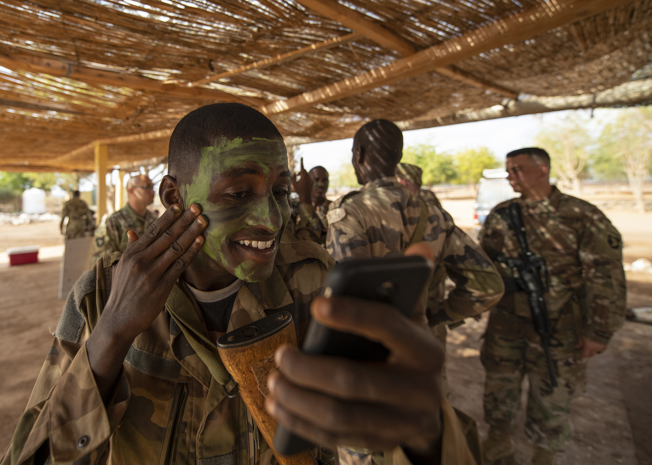 A soldier assigned to the Rapid Intervention Battalion (RIB), the Djiboutian army's elite military force, prepares for a visit from U.S. Marine Corps Gen. Thomas D. Waldhauser, commander of U.S. Africa Command, and Chief of General Staff of the Djibouti Armed Forces Gen. Zakaria Cheik Ibrahim, during the officials' visit at a training base in Djibouti, March 21, 2019. Waldhauser and Zakaria visited in order to discuss the growth and development of Djiboutian security forces. (U.S. Air Force photo by Tech. Sgt. Shawn Nickel