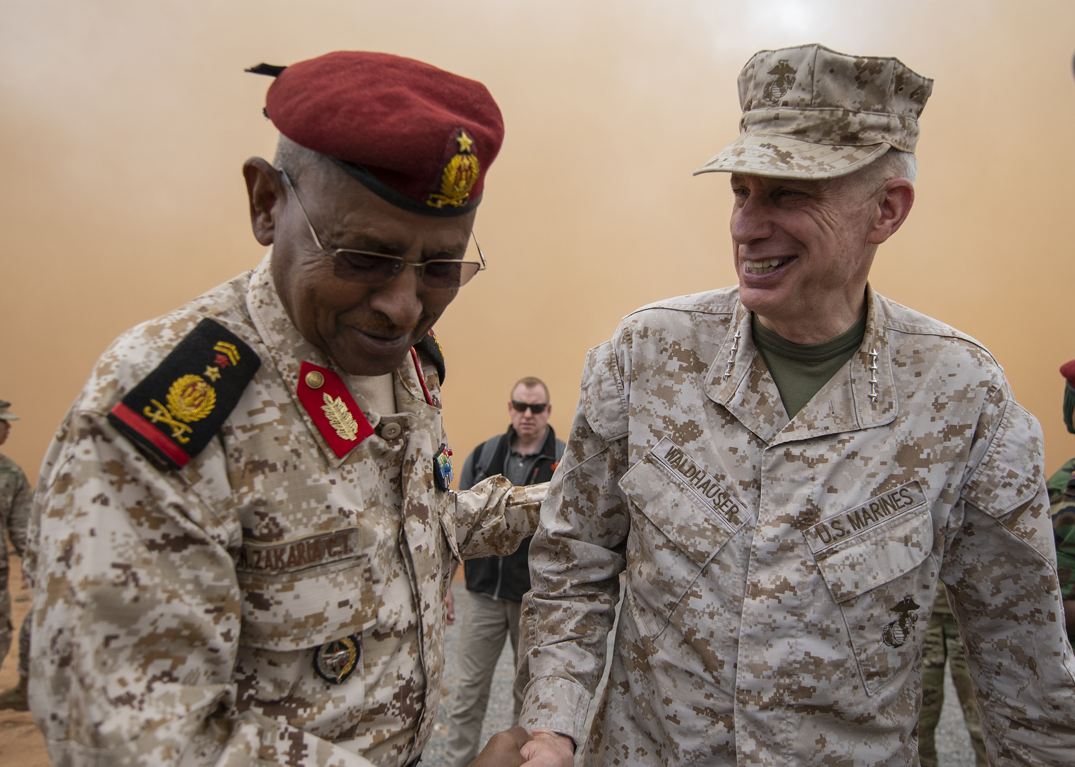 U.S. Marine Corps Gen. Thomas D. Waldhauser, right, commander of U.S. Africa Command, shakes hands with Chief of General Staff of the Djibouti Armed Forces Gen. Zakaria Cheik Ibrahim at a training base in Djibouti, March 21, 2019. While in Djibouti, Waldhauser observed the ongoing growth and development of the Rapid Intervention Battalion, the Djiboutian army's elite military force, which the U.S. is in the process of training and equipping at the request of the Djiboutian government. (U.S. Air Force photo by Tech. Sgt. Shawn Nickel)