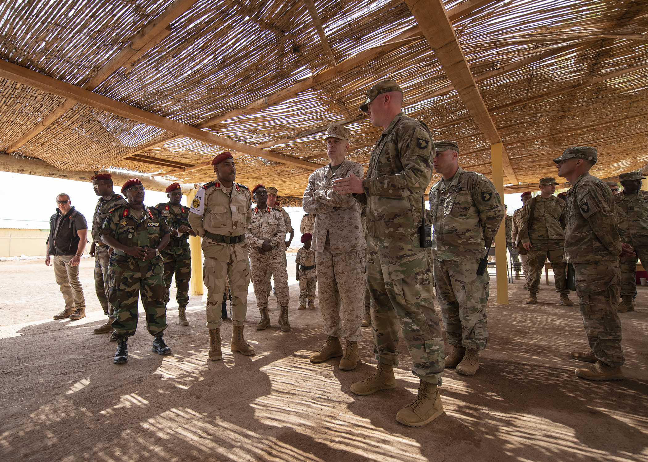 U.S. Marine Corps Gen. Thomas D. Waldhauser, center, commander of U.S. Africa Command, listens to a brief about partner training delivered by the officer in charge of NCO training for the Rapid Intervention Battalion (RIB), U.S. Army 1st Lt. Travis Holihan, Headquarters Company, 1-26 Infantry Battalion, 2nd Brigade Combat Team, 101st Airborne, assigned to Combined Joint Task Force-Horn of Africa, during a visit with senior Djiboutian officials, including Chief of General Staff of the Djibouti Armed Forces Gen. Zakaria Cheik Ibrahim, at a training base in Djibouti, March 21, 2019. While in Djibouti, Waldhauser observed the ongoing growth and development of the RIB, the Djiboutian army's elite military force, which the U.S. is in the process of training and equipping at the request of the Djiboutian government. (U.S. Air Force photo by Tech. Sgt. Shawn Nickel)