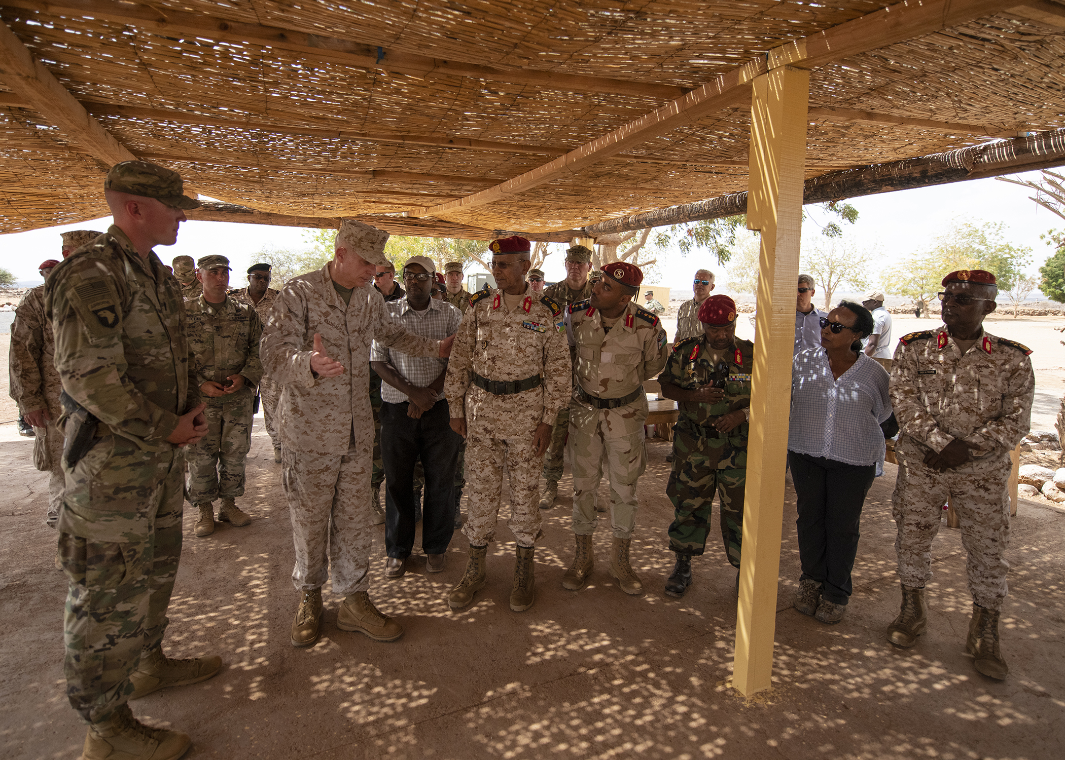 U.S. Marine Corps Gen. Thomas D. Waldhauser, left center, commander of U.S. Africa Command, comments on a brief about partner training delivered bythe officer in charge of NCO training for the Rapid Intervention Battalion (RIB), U.S. Army 1st Lt. Travis Holihan, Headquarters Company, 1-26 Infantry Battalion, 2nd Brigade Combat Team, 101st Airborne, assigned to Combined Joint Task Force-Horn of Africa, during a visit with senior Djiboutian officials, including Chief of General Staff of the Djibouti Armed Forces Zakaria Cheik Ibrahim, at a training base in Djibouti, March 21, 2019. While in Djibouti, Waldhauser observed the ongoing growth and development of the RIB, the Djiboutian army's elite military force, which the U.S. is in the process of training and equipping at the request of the Djiboutian government. (U.S. Air Force photo by Tech. Sgt. Shawn Nickel)