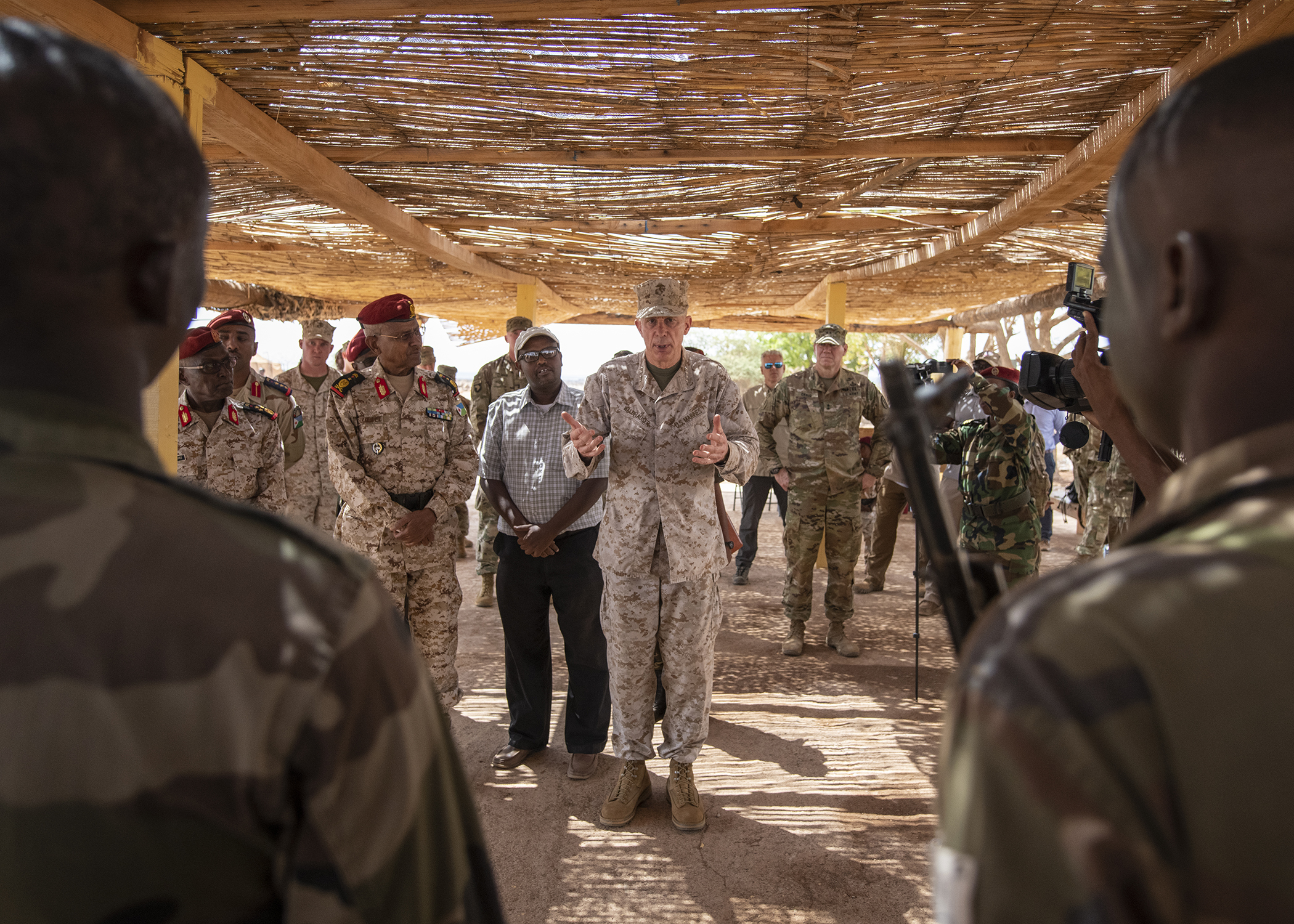 U.S. Marine Corps Gen. Thomas D. Waldhauser, commander of U.S. Africa Command, speaks to soldiers from the Djiboutian army's elite military force, the Rapid Intervention Battalion, after a tactical demonstration during a visit with senior Djiboutian officials, including Chief of General Staff of the Djibouti Armed Forces Zakaria Cheik Ibrahim, at a training base in Djibouti, March 21, 2019. Waldhauser visited in order to discuss the growth and development of Djiboutian security forces. (U.S. Air Force photo by Tech. Sgt. Shawn Nickel)