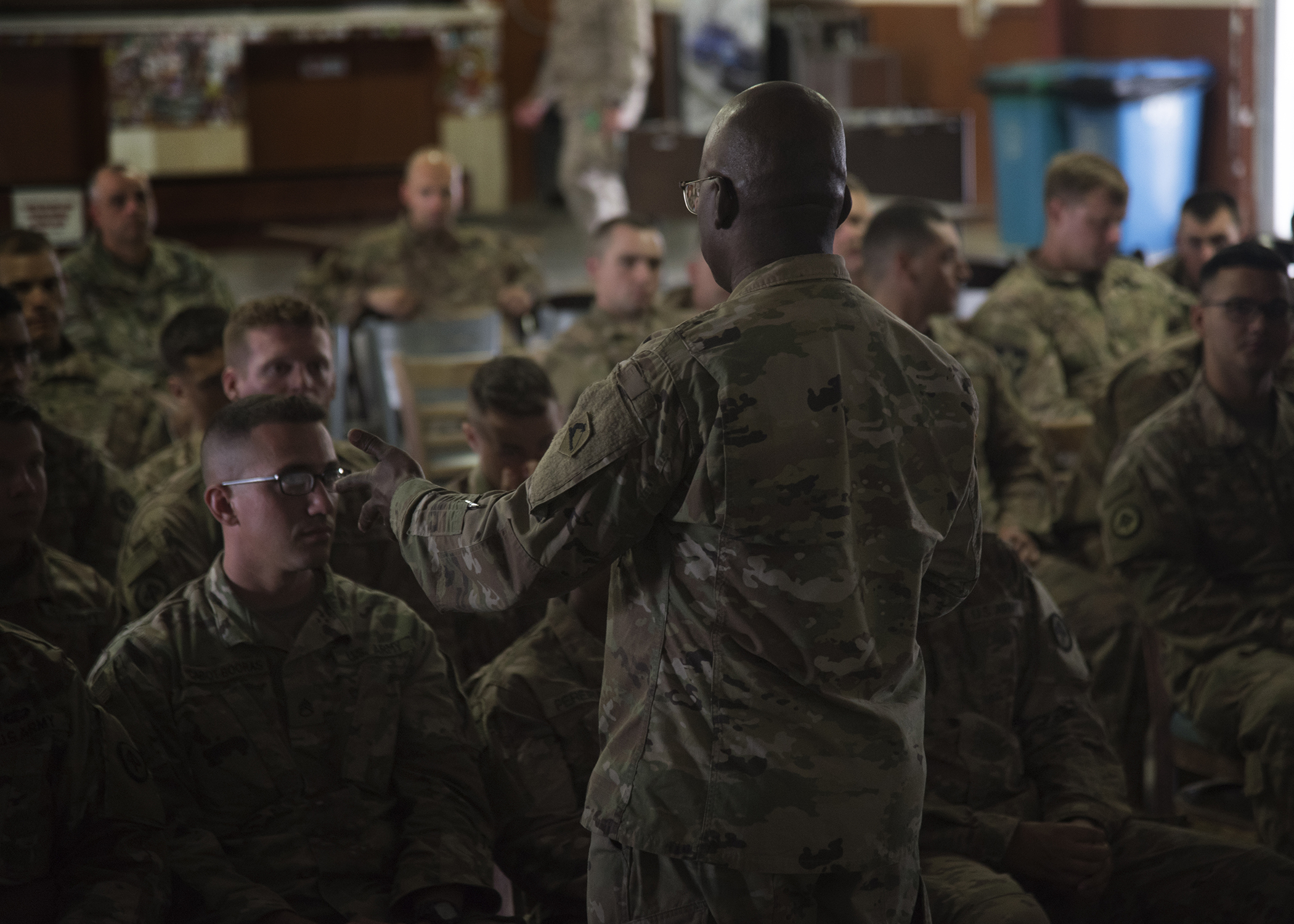 U.S. Army Col. Paul Minor, chaplain with the Massachusetts National Guard, speaks to U.S. Soldiers from the Massachusetts National Guard deployed to Combined Joint Task Force-Horn of Africa (CJTF-HOA), during a battlefield circulation at Camp Lemonnier, Djibouti, April 25, 2019. Minor met with more than 80 Massachusetts National Guard Soldiers assigned to, Charlie Company, 1st Battalion, 181st Infantry Regiment, mobilized to support Task Force Warrior, prior to visiting Kenya, which is Massachusetts' assigned country under the Department of Defense National Guard State Partnership Program. (U.S. Air Force Photo by Senior Airman Kirsten Brandes)
