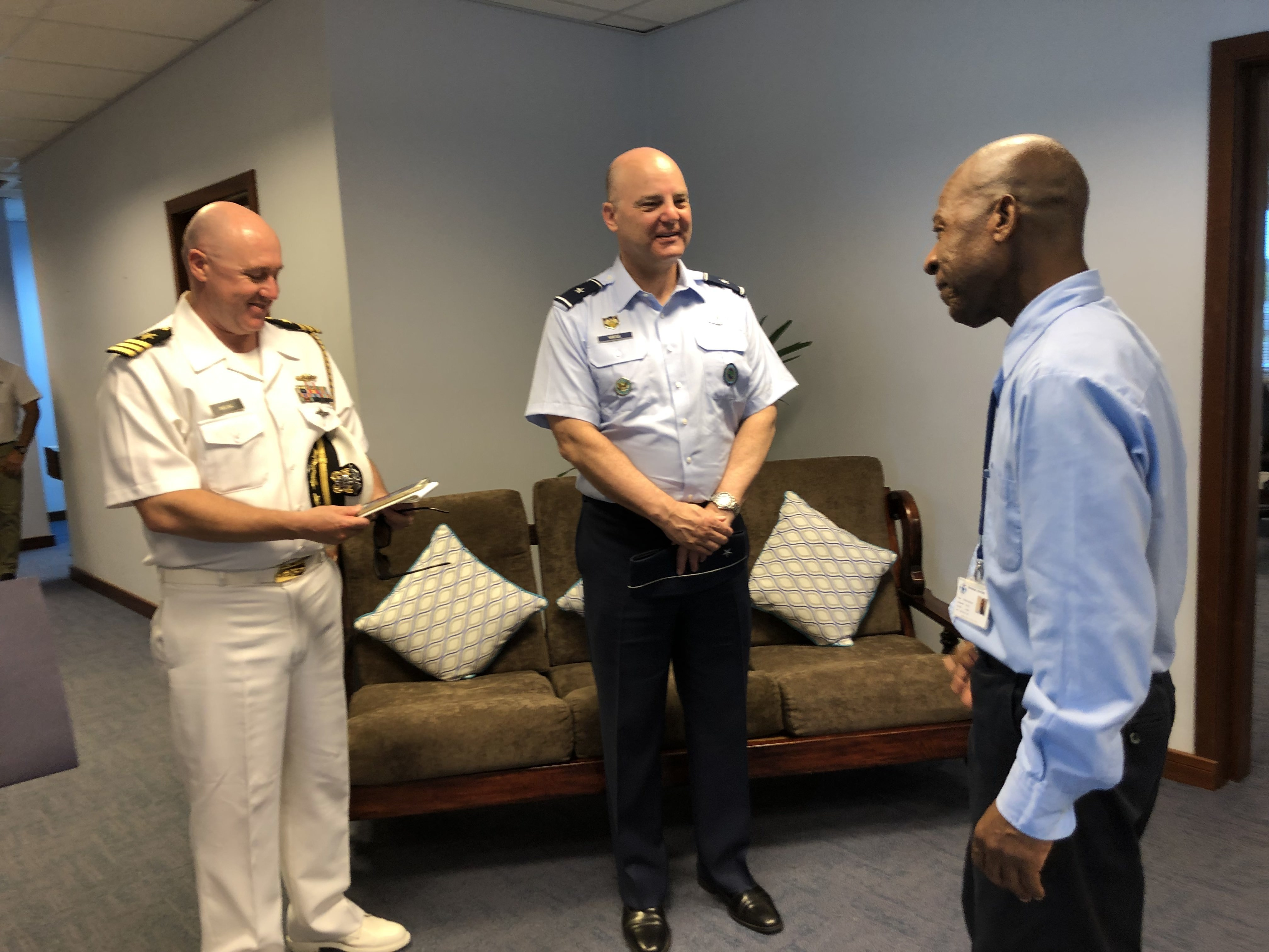 U.S. Air Force Brig. Gen. James R. Kriesel, center, deputy commanding general of Combined Joint Task Force-Horn of Africa (CJTF-HOA), meets with a staff member at the Regional Centre for Operations Coordination (RCOC) in Seychelles, March 26, 2019. The RCOC, modeled after the Regional Maritime Information Exchange and Sharing Mechanism in Madagascar, helps provide a more effective and coordinated fight against piracy in the region. (Courtesy Photo)