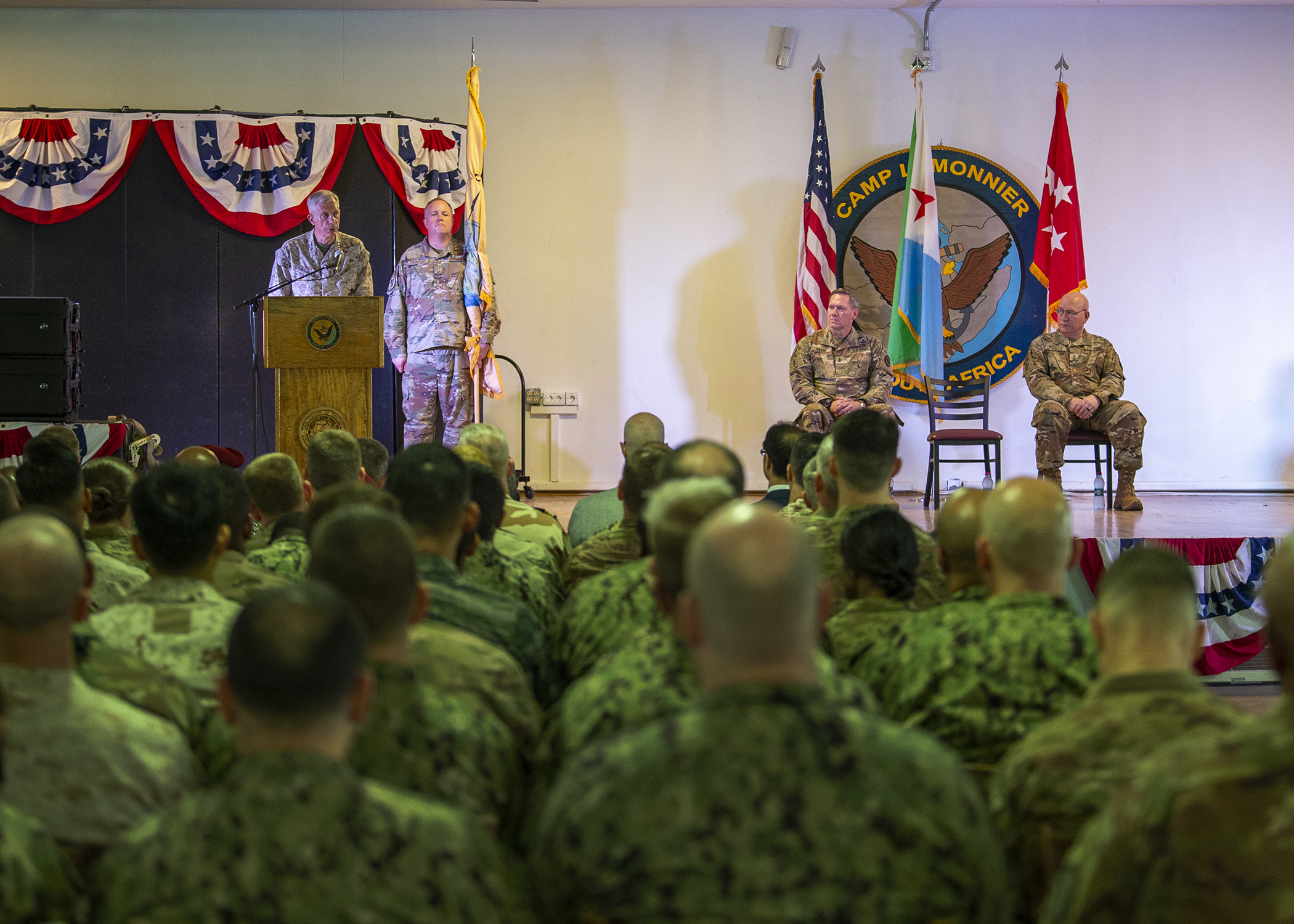 U.S. Marine Corps Gen. Thomas Waldhauser, commander of U.S. Africa Command, middle, gives remarks during a change of command ceremony for Combined Joint Task Force-Horn of Africa (CJTF-HOA) at Camp Lemonnier, Djibouti, June 12, 2019. U.S. Army Maj. Gen. James D. Craig, outgoing commanding general of CJTF-HOA, transferred responsibility to U.S. Army Maj. Gen. Michael D. Turello in the ceremony with Waldhauser as the presiding officer. (U.S. Air Force photo by Tech. Sgt. Shawn Nickel)