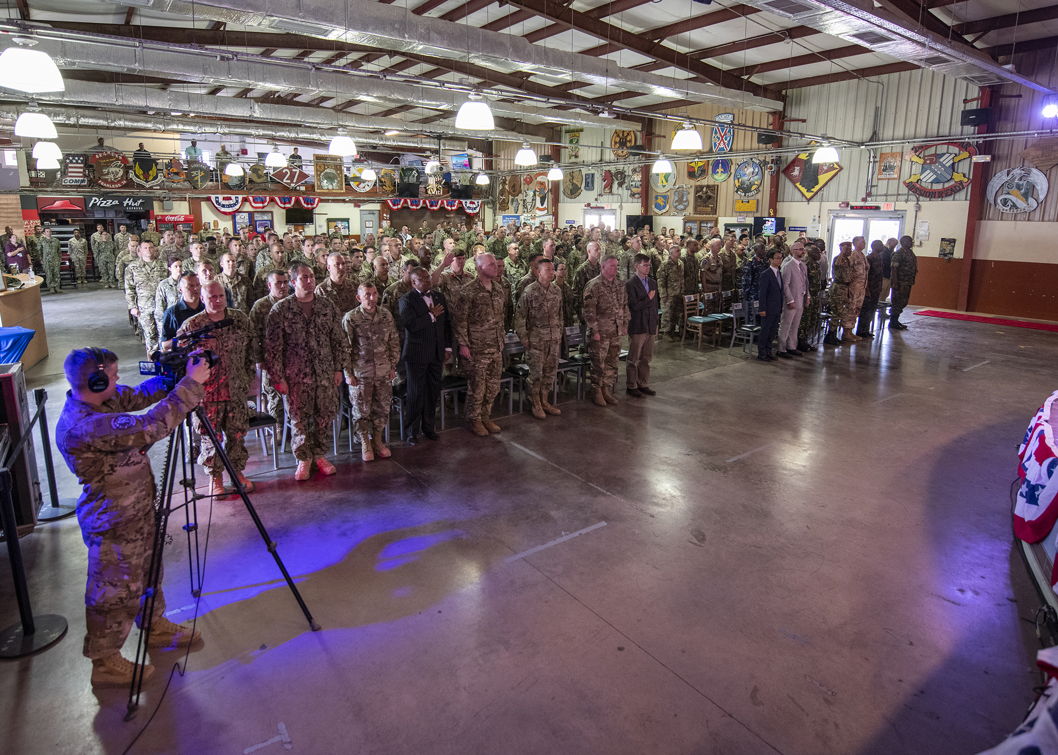 Combined Joint Task Force-Horn of Africa (CJTF-HOA) personnel, joint partners and members of the international community stand at attention during a change of command ceremony for CJTF-HOA at Camp Lemonnier, Djibouti, June 12, 2019. U.S. Army Maj. Gen. James D. Craig, outgoing commanding general of CJTF-HOA, transferred responsibility to U.S. Army Maj. Gen. Michael D. Turello in the ceremony with U.S. Marine Corps Gen. Thomas Waldhauser, commander of U.S. Africa Command, as the presiding officer. (U.S. Air Force photo by Tech. Sgt. Shawn Nickel)