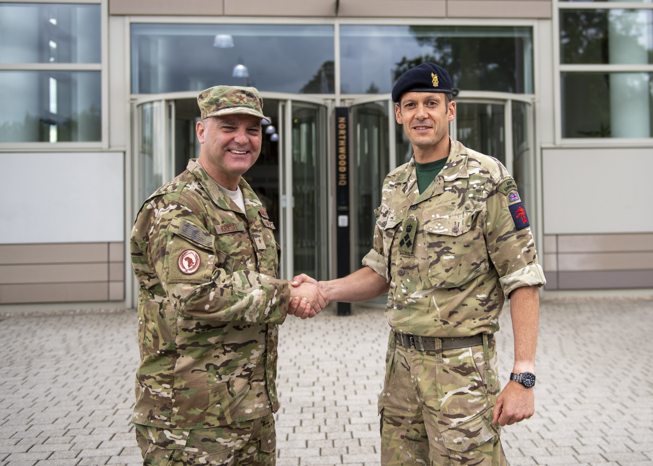 U.S. Air Force Brig. Gen. James R. Kriesel, deputy commanding general of Combined Joint Task Force-Horn of Africa, left, shake hands with Brig. John Ridge, chief of joint force operations at Permanent Joint Headquarters (PJHQ), at PJHQ, June 5, 2019. Kriesel visited the U.K. to build relations with leaders across the Ministry of Defense and familiarize himself with the partner nation's information exchange policies, which is mission essential in support of national objectives. (U.S. Air Force photo by Tech. Sgt. Shawn Nickel)
