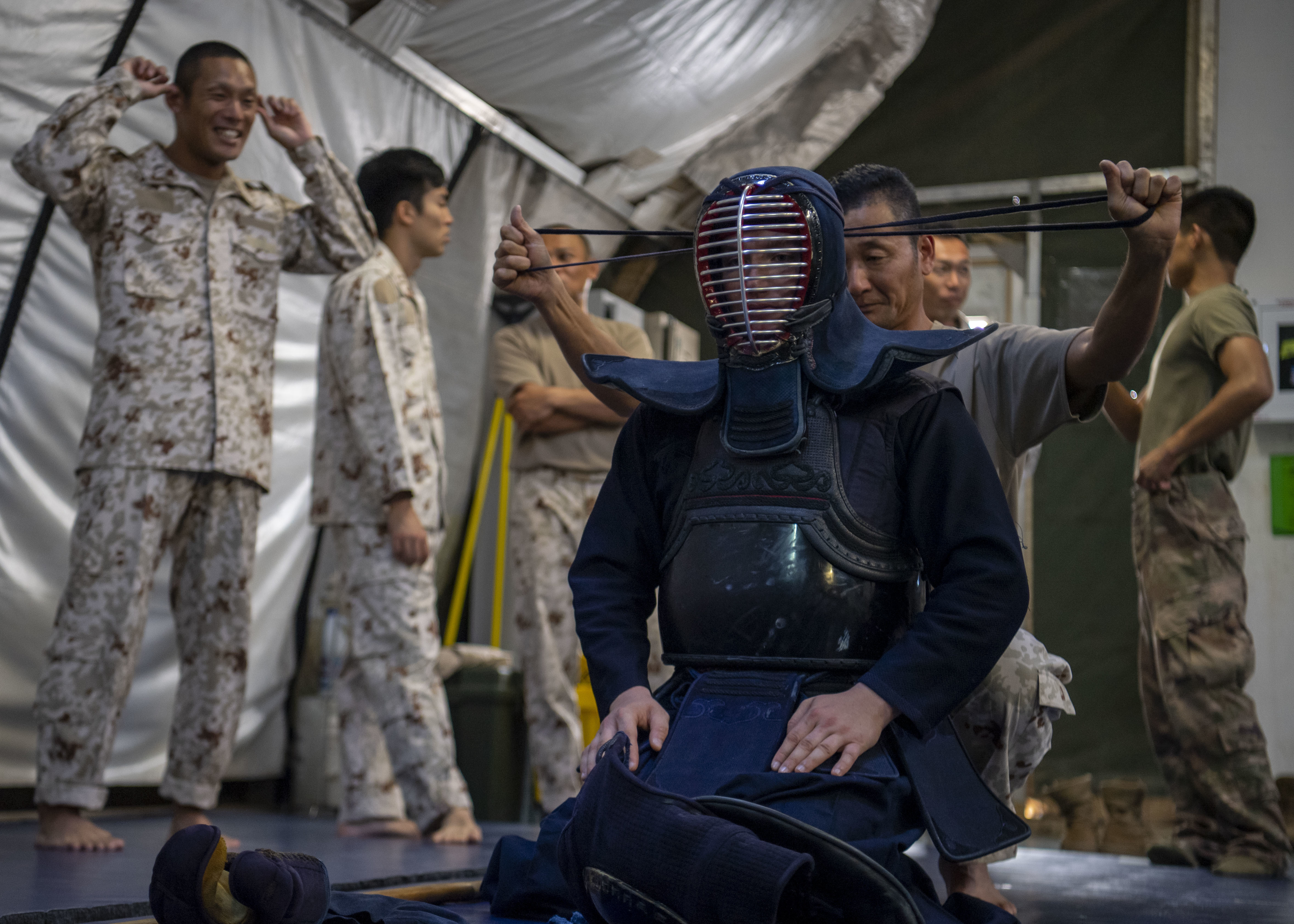 U.S. Army Spc. Davin Gould, infantrymen, 101st Division, 1st Battalion, 26th Infantry Regiment, Task Force Warrior, assigned Combined Joint Task Force-Horn of Africa (CJTF-HOA), is dressed in traditional jukendo attire during a combatives exchange with the Japanese Ground Self-Defense Force (JGSDF) at Camp Lemonnier, Djibouti, July 1, 2019. The purpose of the joint exchange was to share Japanese combative techniques and forge relationships between CJTF-HOA and the JGSDF. (U.S. Air Force photo by Staff Sgt. J.D. Strong II) (U.S. Air Force photo by Staff Sgt. J.D. Strong II)