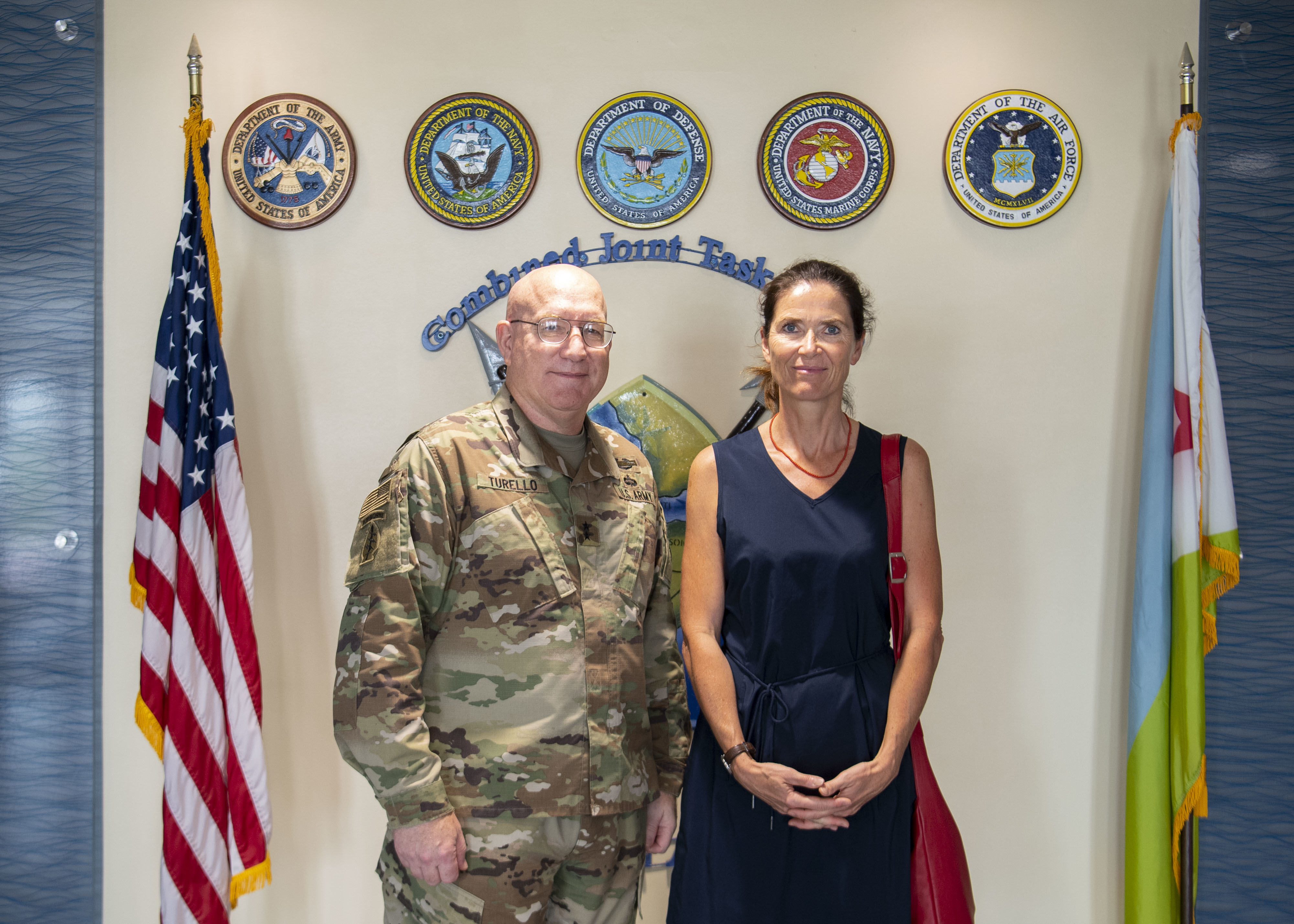 U.S. Army Maj. Gen. Michael D. Turello, commanding general of Combined Joint Task Force-Horn of Africa (CJTF-HOA), left, poses for a photo with Anke Holstein, Ambassador of Germany to Djibouti, at Camp Lemonnier, Djibouti, July 3, 2019. While visiting Camp Lemonnier, Holstein learned about the CJTF-HOA mission and toured the installation. (U.S. Air Force photo by Staff Sgt. J.D. Strong II)