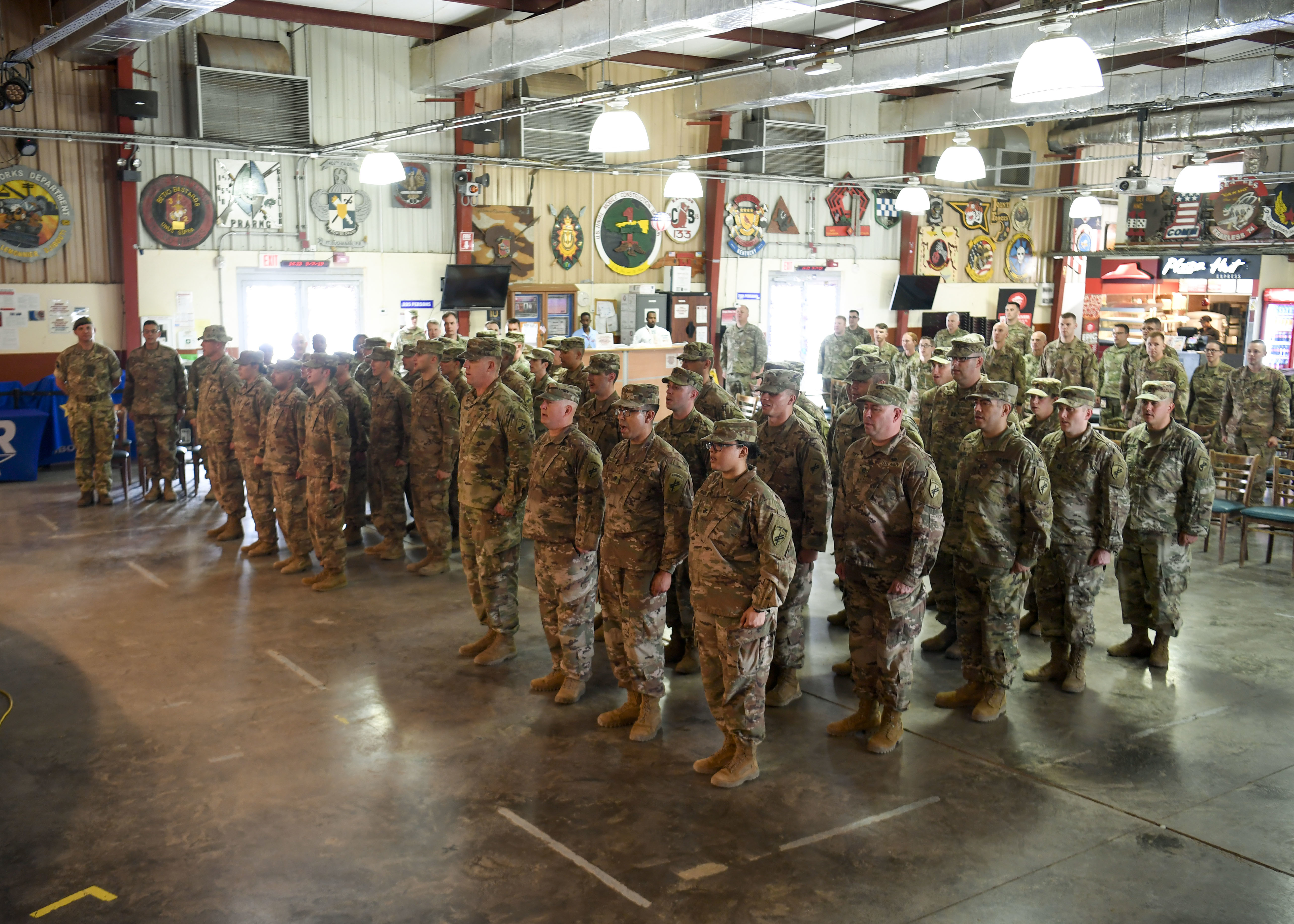 U.S. Army Soldiers from the 403d and 411th Civil Affairs (CA) Battalions, assigned to Combined Joint Task Force-Horn of Africa (CJTF-HOA), sing the U.S. Army song during a transfer of authority ceremony at Camp Lemonnier, Djibouti, July 9, 2019. The 411th CA Battalion assumed civil affairs responsibilities for CJTF-HOA from the 403rd CA Battalion. Civil Affairs Soldiers are the governance and foreign-culture experts of the Army. (U.S. Air Force photo by Staff Sgt. J.D. Strong II)