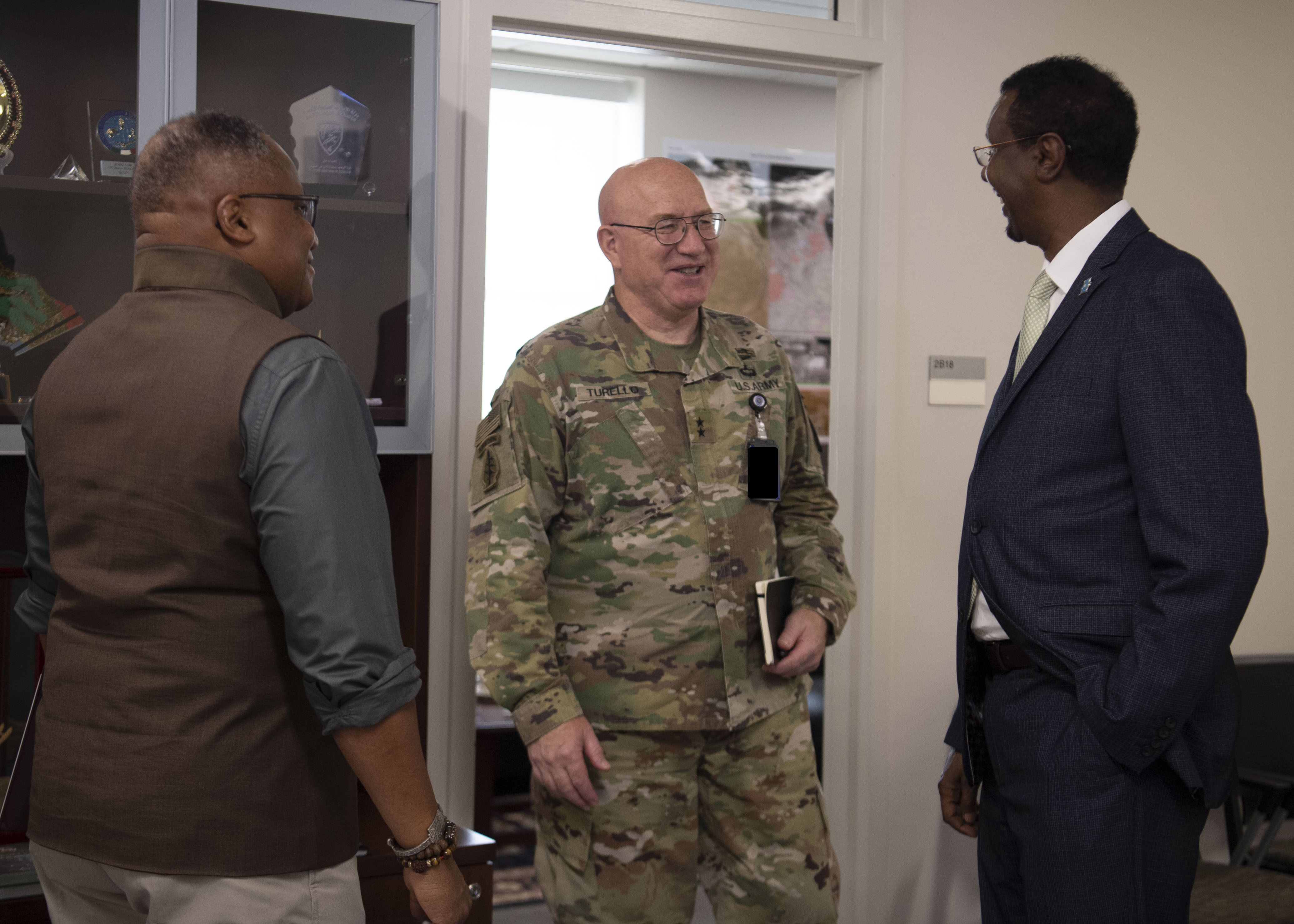 Irvin Hicks Jr., Combined Joint Task Force-Horn of Africa (CJTF-HOA) foreign policy advisor (POLAD), left, and U.S. Army Maj. Gen. Michael D. Turello, commanding general, CJTF-HOA, center, greet Dr. Mohamed Ali-Nur Hagi, Somalia ambassador to Djibouti, at Camp Lemonnier, Djibouti, July 8, 2019. Hagi visited Camp Lemonnier to learn about the CJTF-HOA mission and its contributions to East Africa. (U.S. Air Force photo by Staff Sgt. J.D. Strong II)